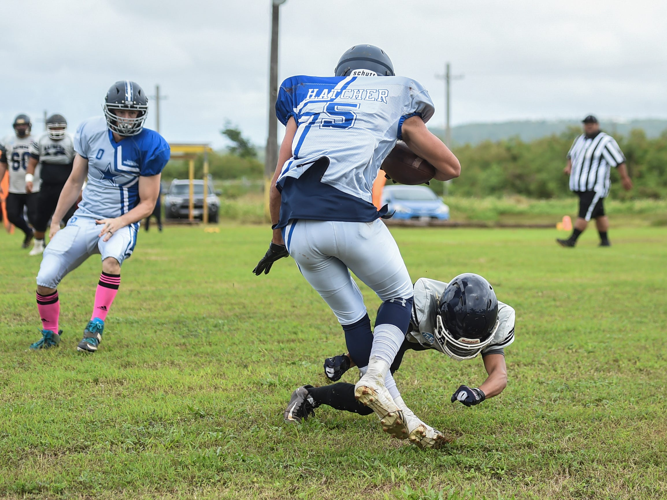 Logan Hatcher (5) of the Southern Cowboys avoids a tackle by a Guam Raiders player during their Budweiser Guahan Varsity Football League game at Eagles Field in Mangilao, Feb. 2, 2019.