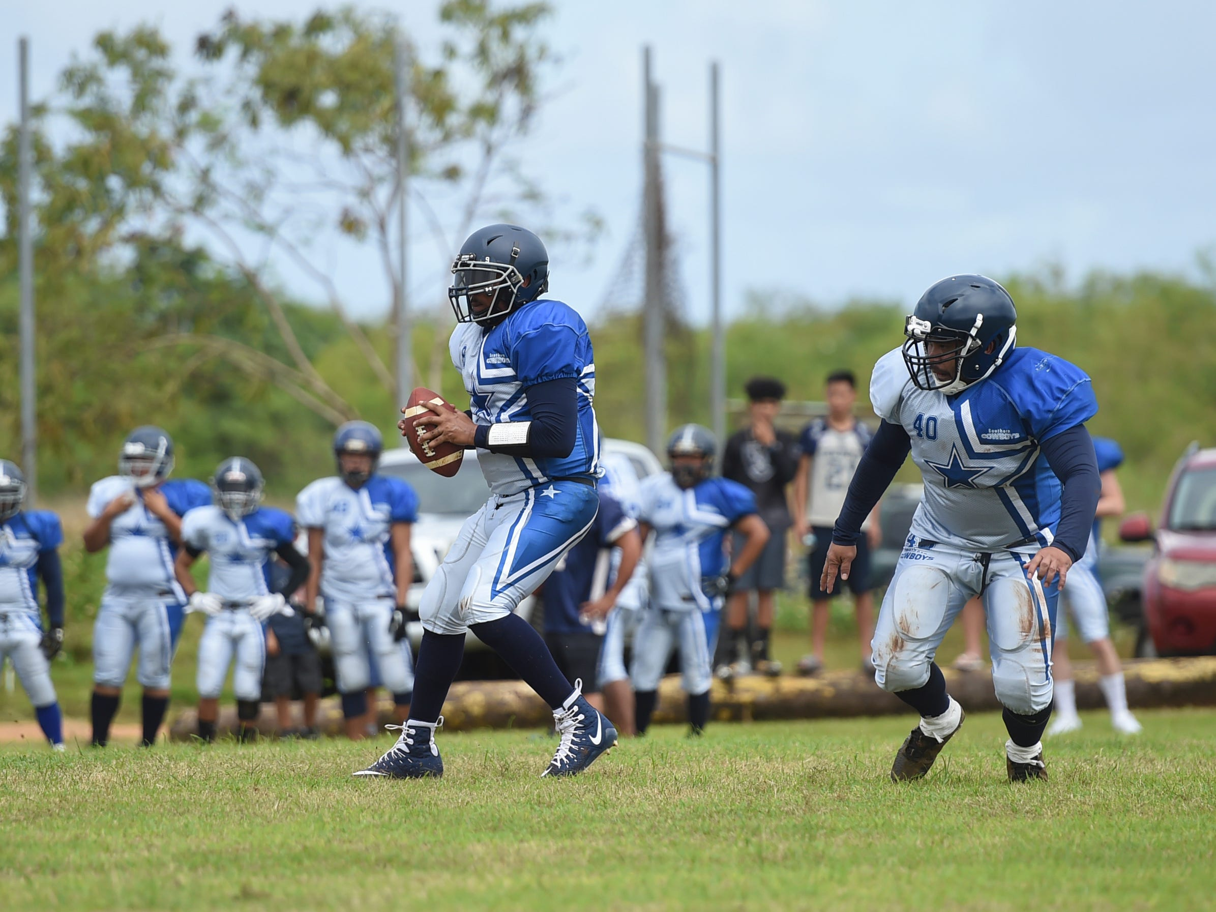 Southern Cowboys quarterback Smokee Hughes looks to make a pass against the Guam Raiders during their Budweiser Guahan Varsity Football League game at Eagles Field in Mangilao, Feb. 2, 2019.
