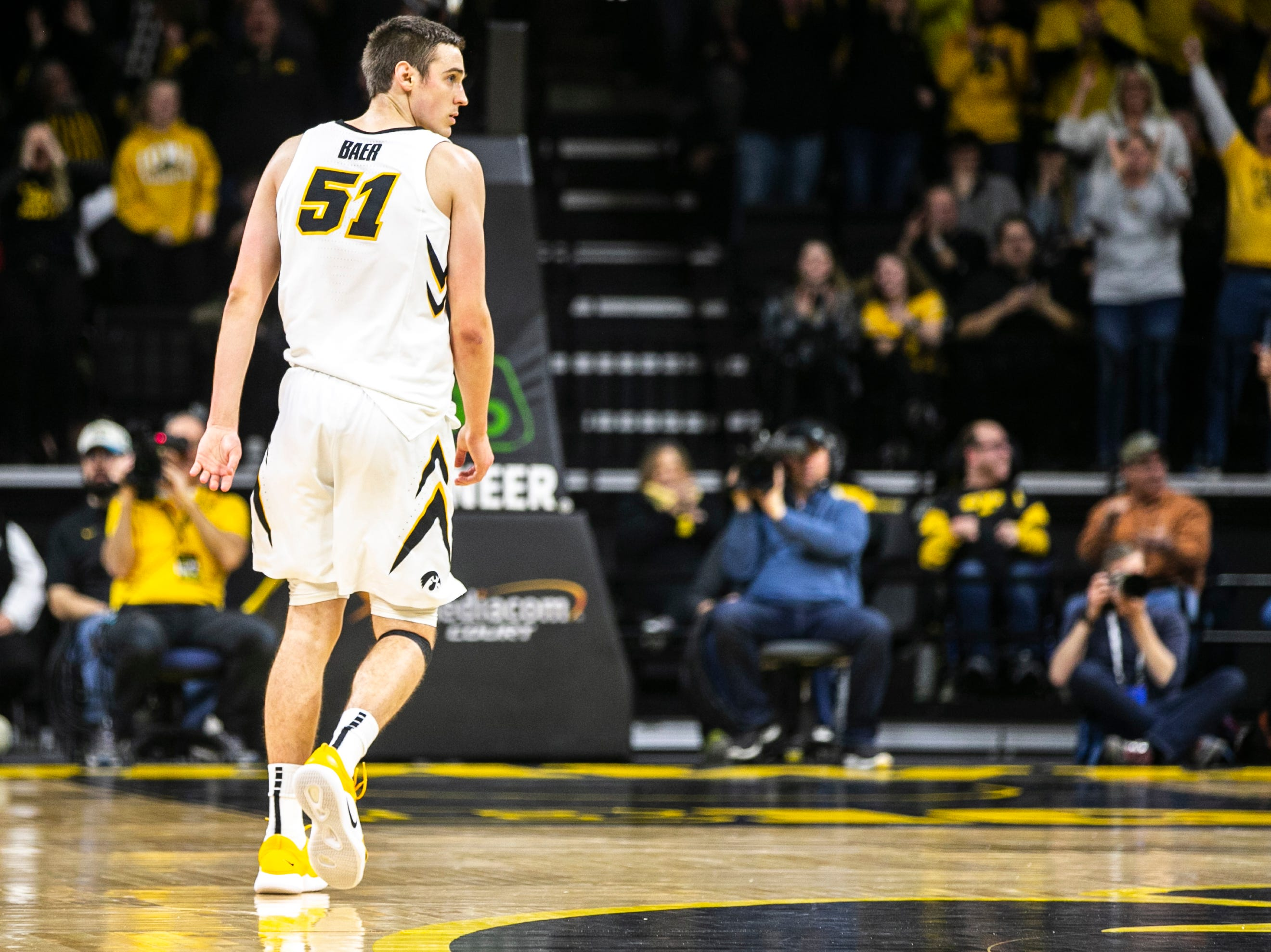 Iowa forward Nicholas Baer (51) reacts after making a 3-point basket during a NCAA Big Ten Conference men's basketball game on Friday, Feb. 1, 2019, at Carver-Hawkeye Arena in Iowa City, Iowa.