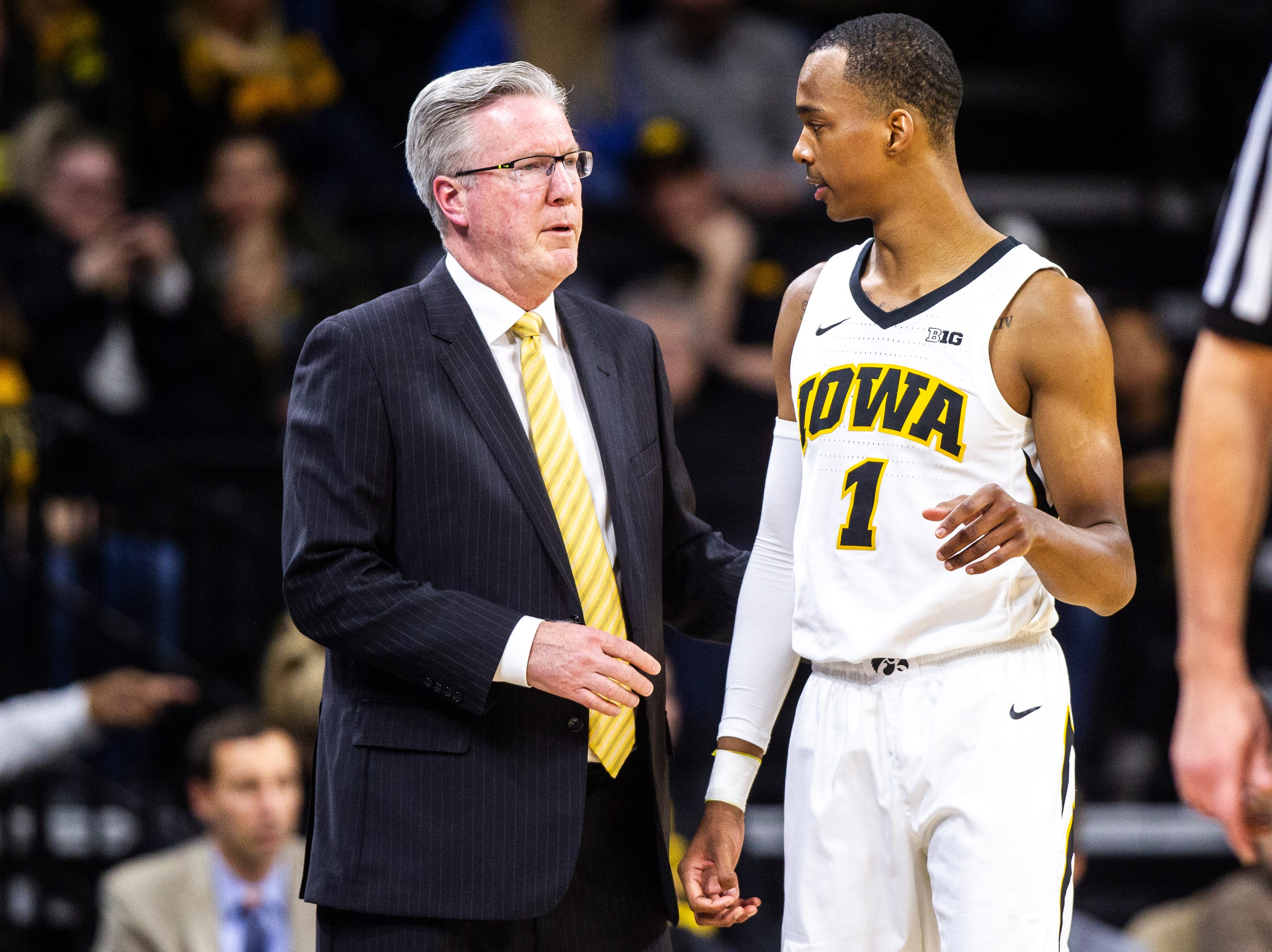 Iowa men's basketball head coach Fran McCaffery talks with Iowa guard Maishe Dailey (1) during a NCAA Big Ten Conference men's basketball game on Friday, Feb. 1, 2019, at Carver-Hawkeye Arena in Iowa City, Iowa.