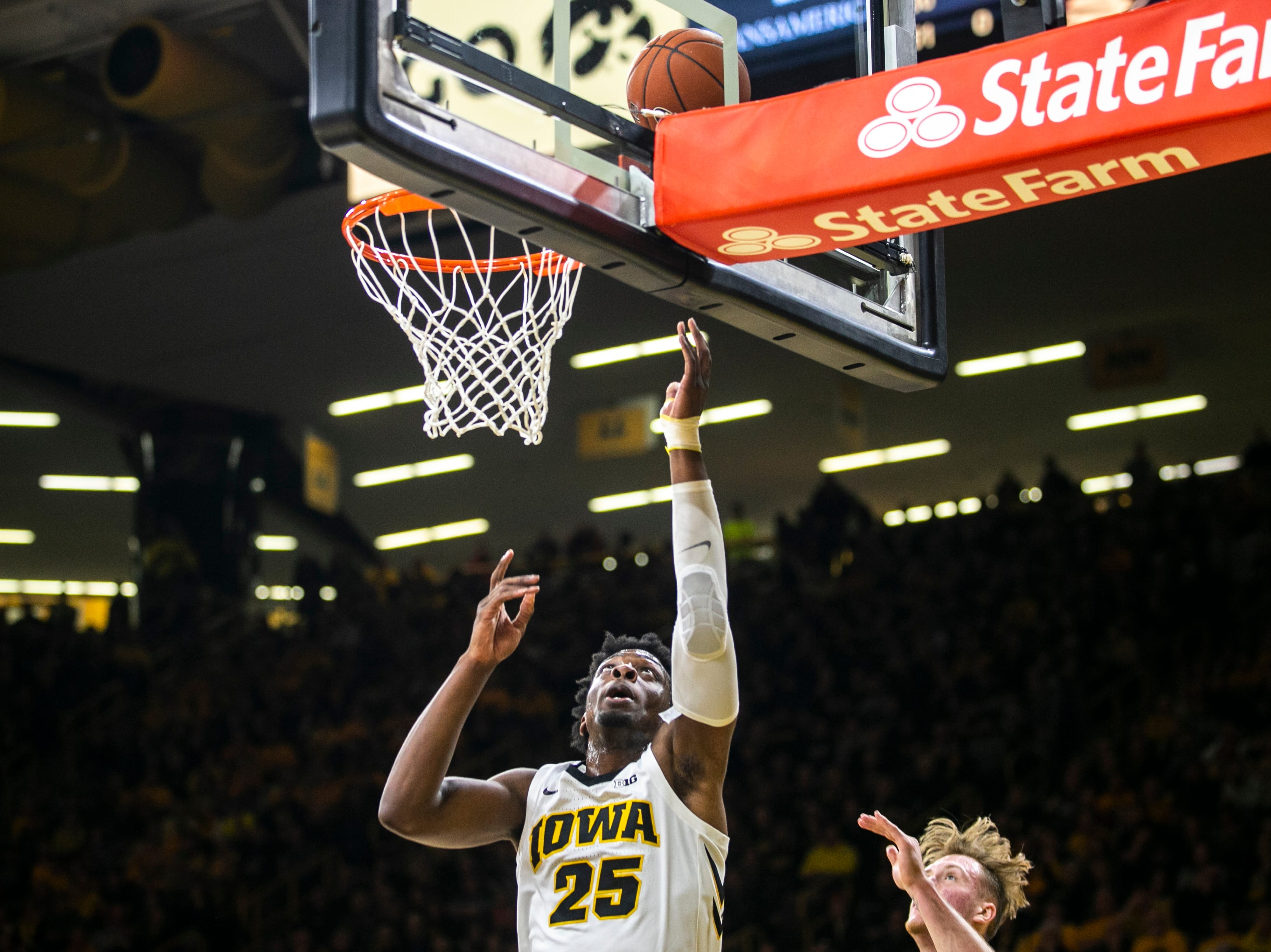 Iowa forward Tyler Cook (25) makes a layup during a NCAA Big Ten Conference men's basketball game on Friday, Feb. 1, 2019, at Carver-Hawkeye Arena in Iowa City, Iowa.