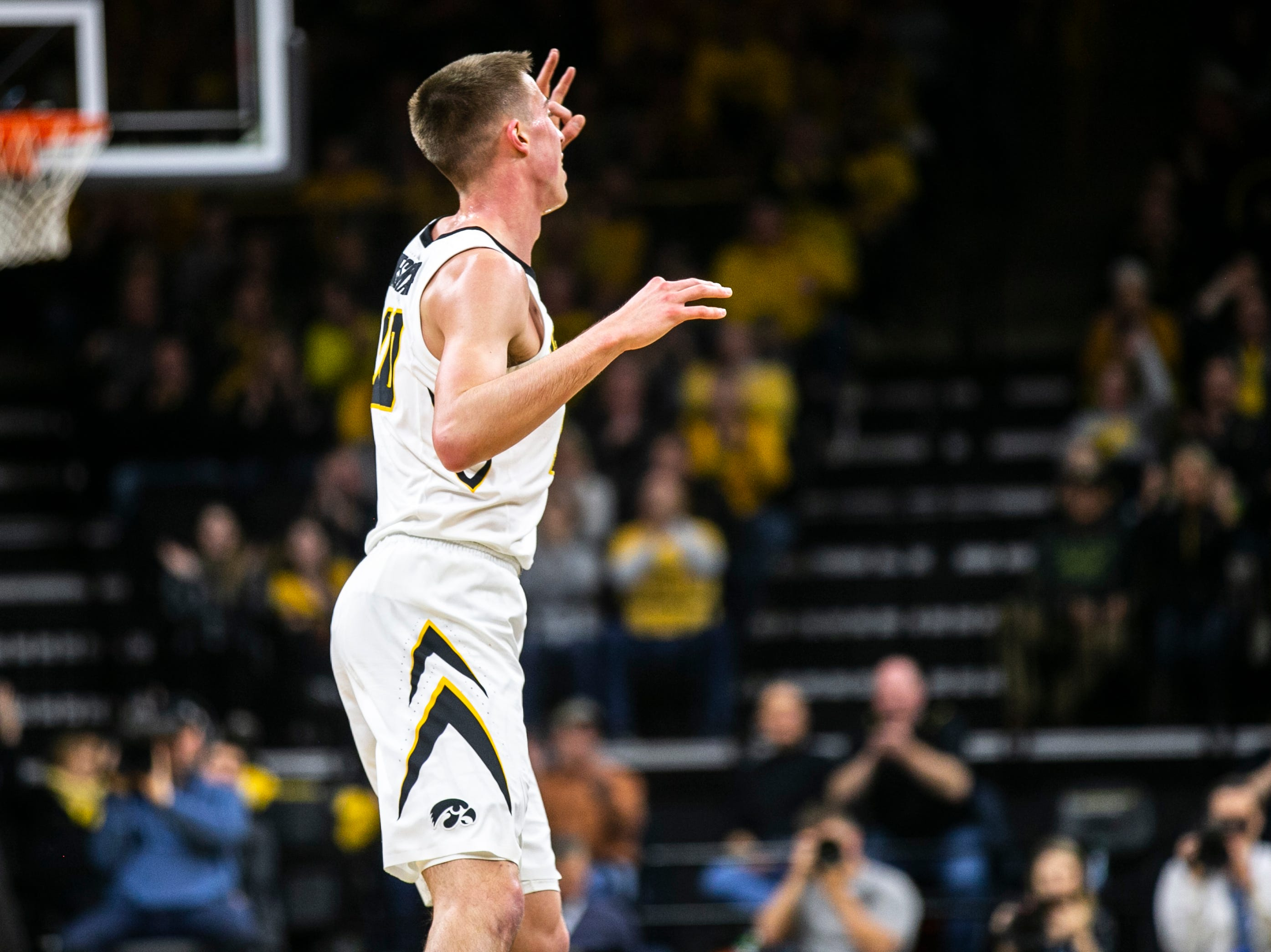Iowa guard Joe Wieskamp (10) celebrates after making a 3-point basket during a NCAA Big Ten Conference men's basketball game on Friday, Feb. 1, 2019, at Carver-Hawkeye Arena in Iowa City, Iowa.