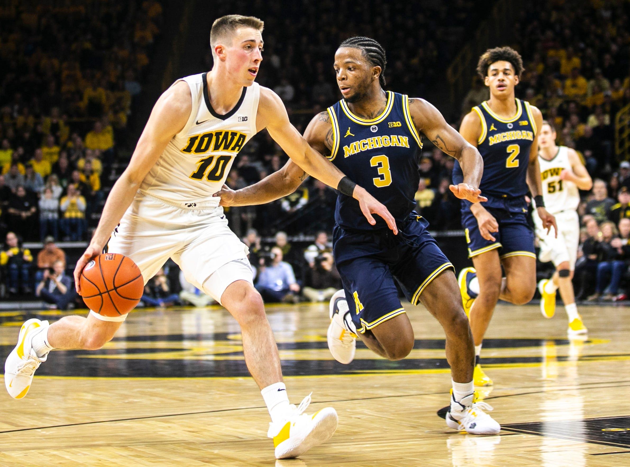 Iowa guard Joe Wieskamp (10) drives to the basket while Michigan guard Zavier Simpson (3) defends during a NCAA Big Ten Conference men's basketball game on Friday, Feb. 1, 2019, at Carver-Hawkeye Arena in Iowa City, Iowa.