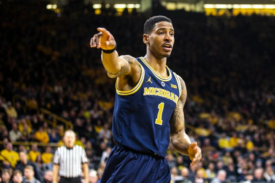 Michigan guard Charles Matthews (1) gestures for possession during a NCAA Big Ten Conference men's basketball game on Friday, Feb. 1, 2019, at Carver-Hawkeye Arena in Iowa City, Iowa.