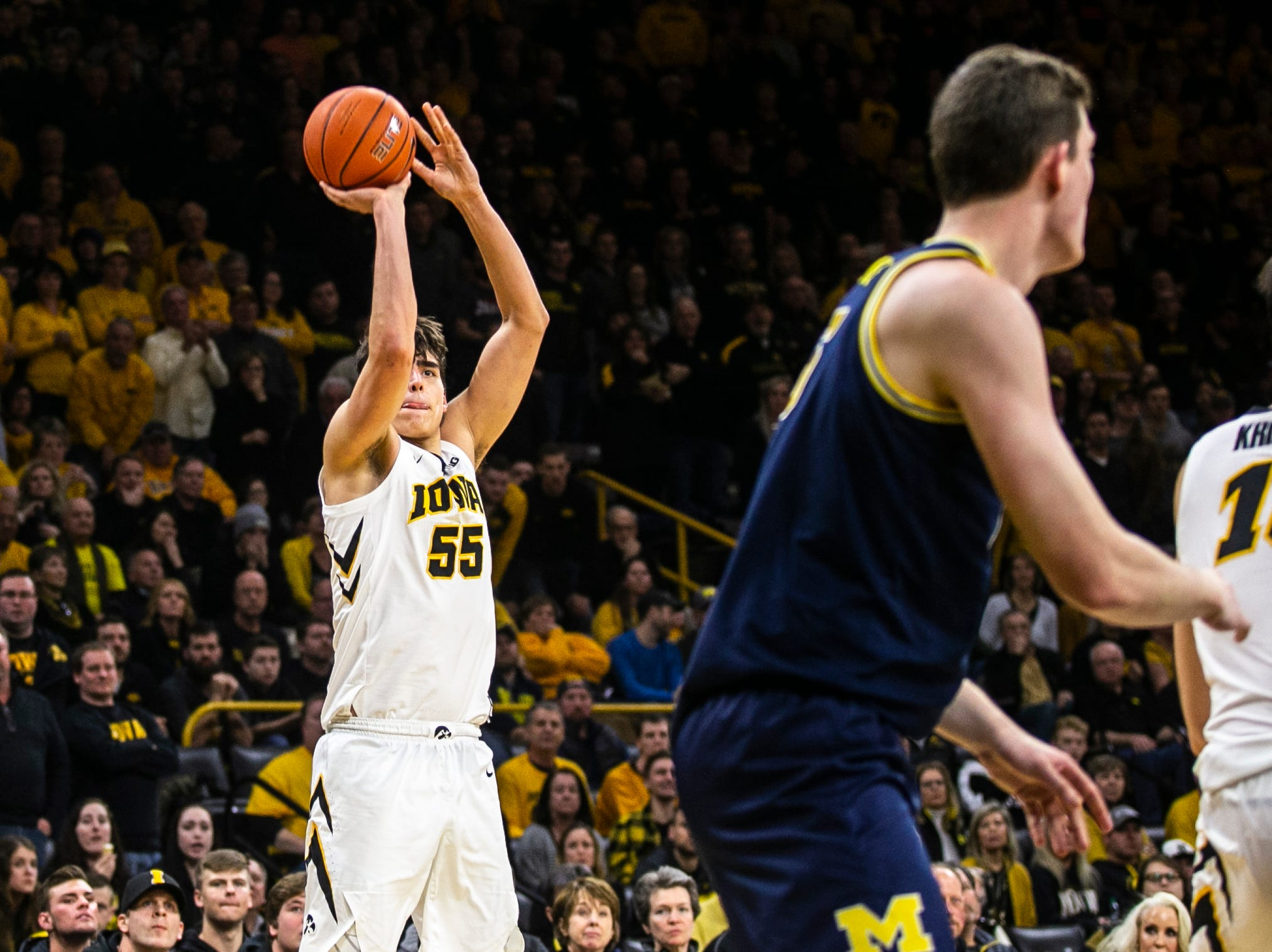 Iowa forward Luka Garza (55) shoots a 3-point basket during a NCAA Big Ten Conference men's basketball game on Friday, Feb. 1, 2019, at Carver-Hawkeye Arena in Iowa City, Iowa.