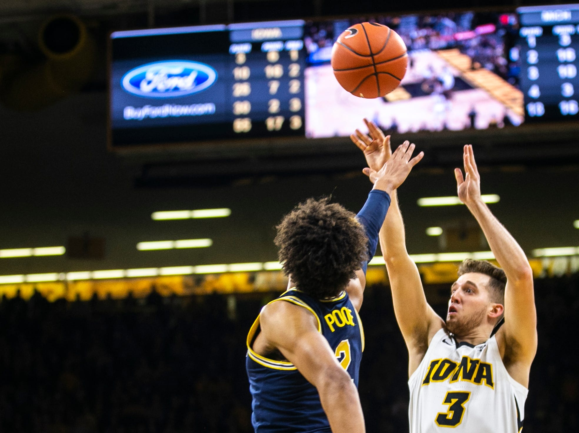 Iowa guard Jordan Bohannon (3) attempts a 3-point basket during a NCAA Big Ten Conference men's basketball game on Friday, Feb. 1, 2019, at Carver-Hawkeye Arena in Iowa City, Iowa.