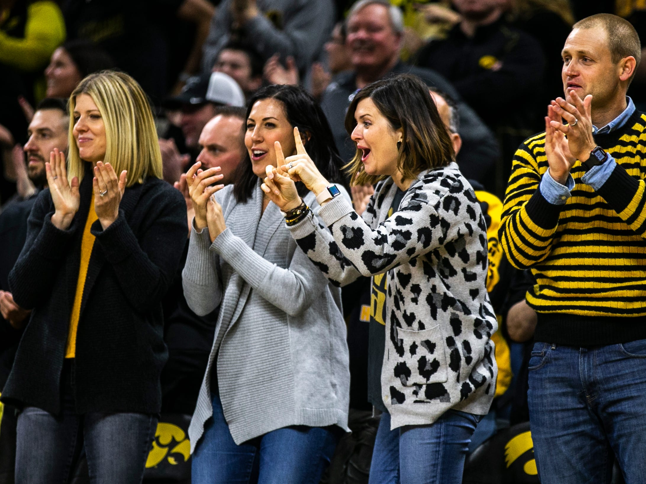 Nate Kaeding, far right, cheers during a NCAA Big Ten Conference men's basketball game on Friday, Feb. 1, 2019, at Carver-Hawkeye Arena in Iowa City, Iowa.
