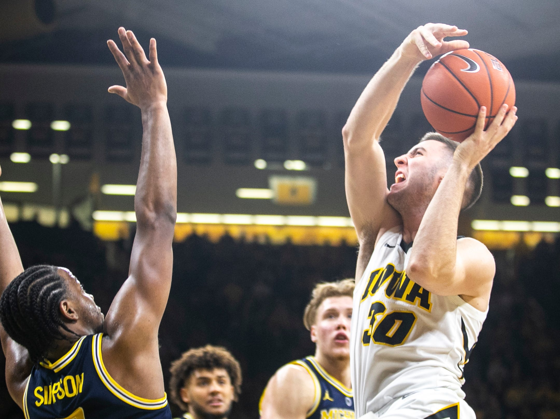 Iowa guard Connor McCaffery (30) drives to the hoop past during a NCAA Big Ten Conference men's basketball game on Friday, Feb. 1, 2019, at Carver-Hawkeye Arena in Iowa City, Iowa.