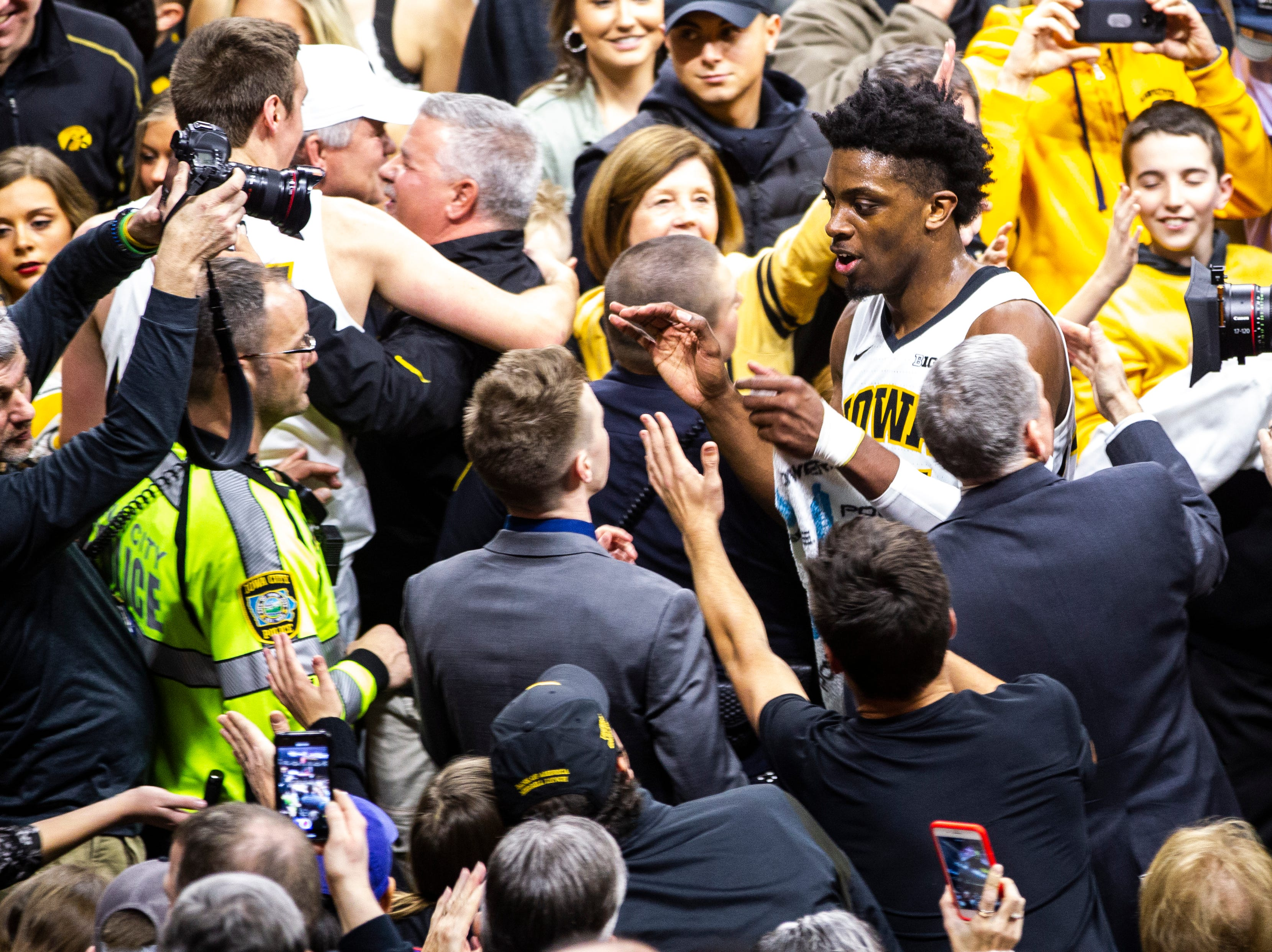 Iowa forward Tyler Cook (25) makes his way off the court while fans celebrate after a NCAA Big Ten Conference men's basketball game on Friday, Feb. 1, 2019, at Carver-Hawkeye Arena in Iowa City, Iowa. The Hawkeyes defeated Michigan's Wolverines, 74-59.