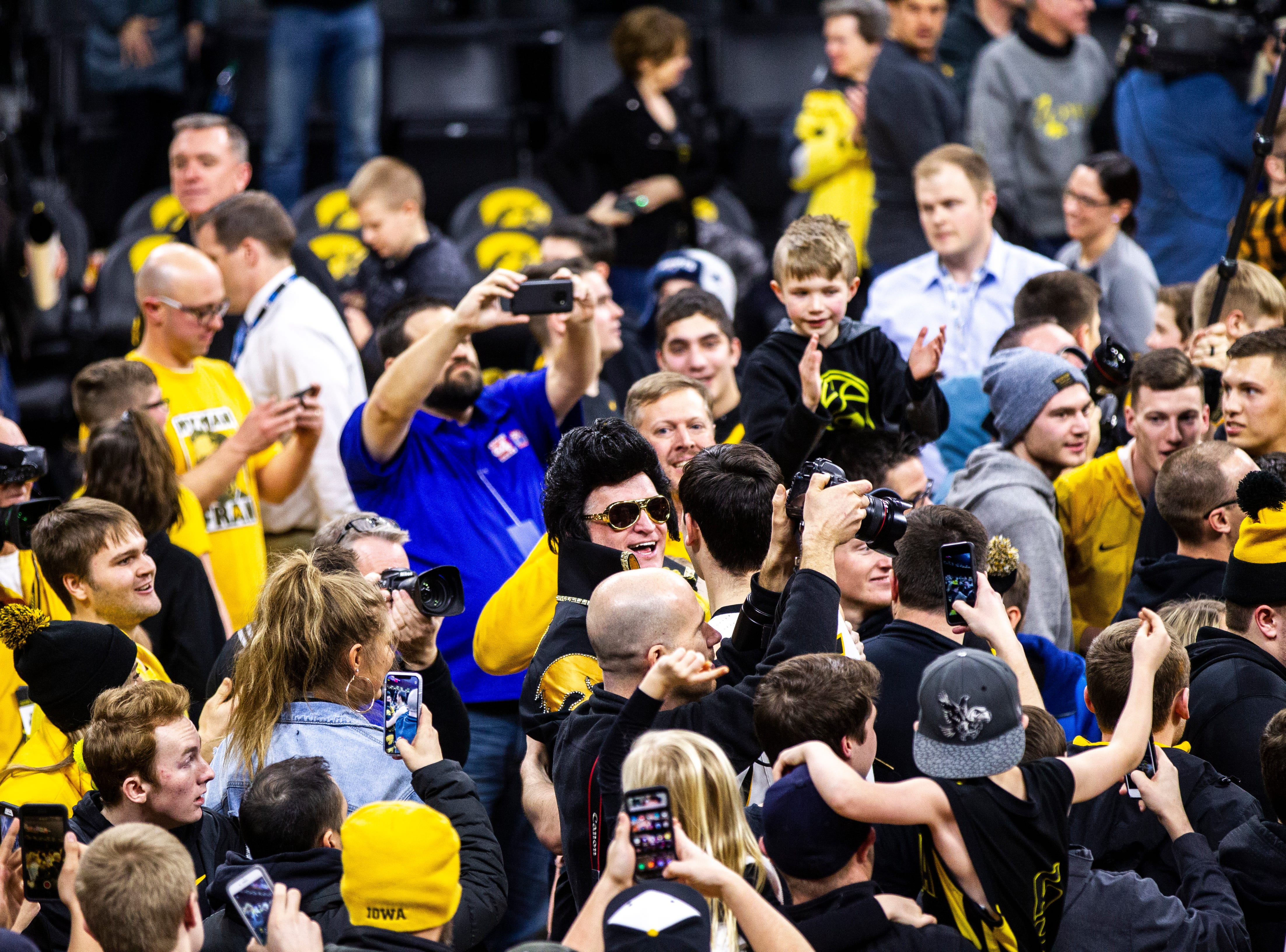 "Iowa forward Ryan Kriener (15) celebrates with ""Hawkeye Elvis"" during a NCAA Big Ten Conference men's basketball game on Friday, Feb. 1, 2019, at Carver-Hawkeye Arena in Iowa City, Iowa."