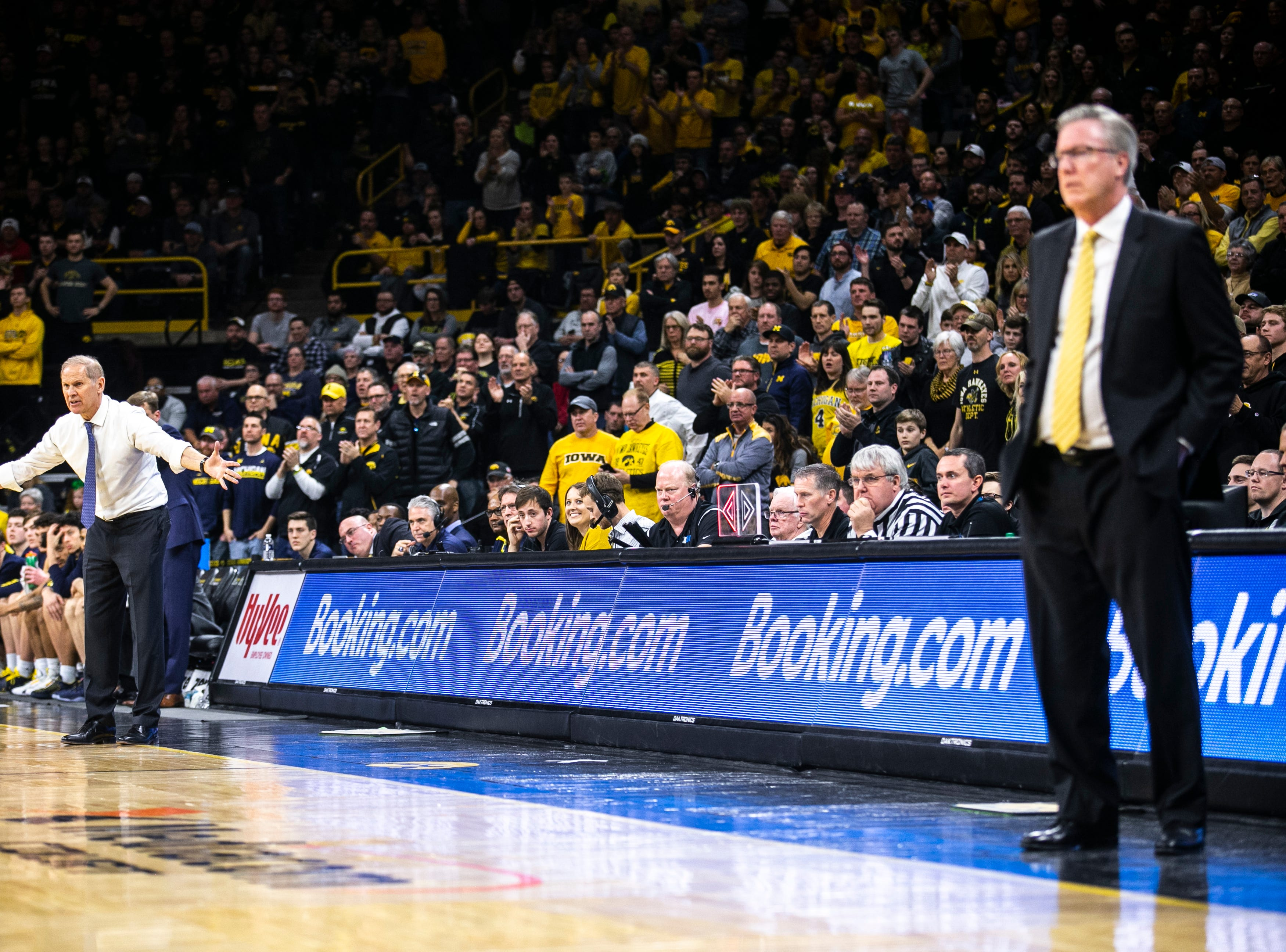 Michigan head coach Jim Beilein, far left, gestures while Iowa men's basketball head coach Fran McCaffery stands along the baseline during a NCAA Big Ten Conference men's basketball game on Friday, Feb. 1, 2019, at Carver-Hawkeye Arena in Iowa City, Iowa.