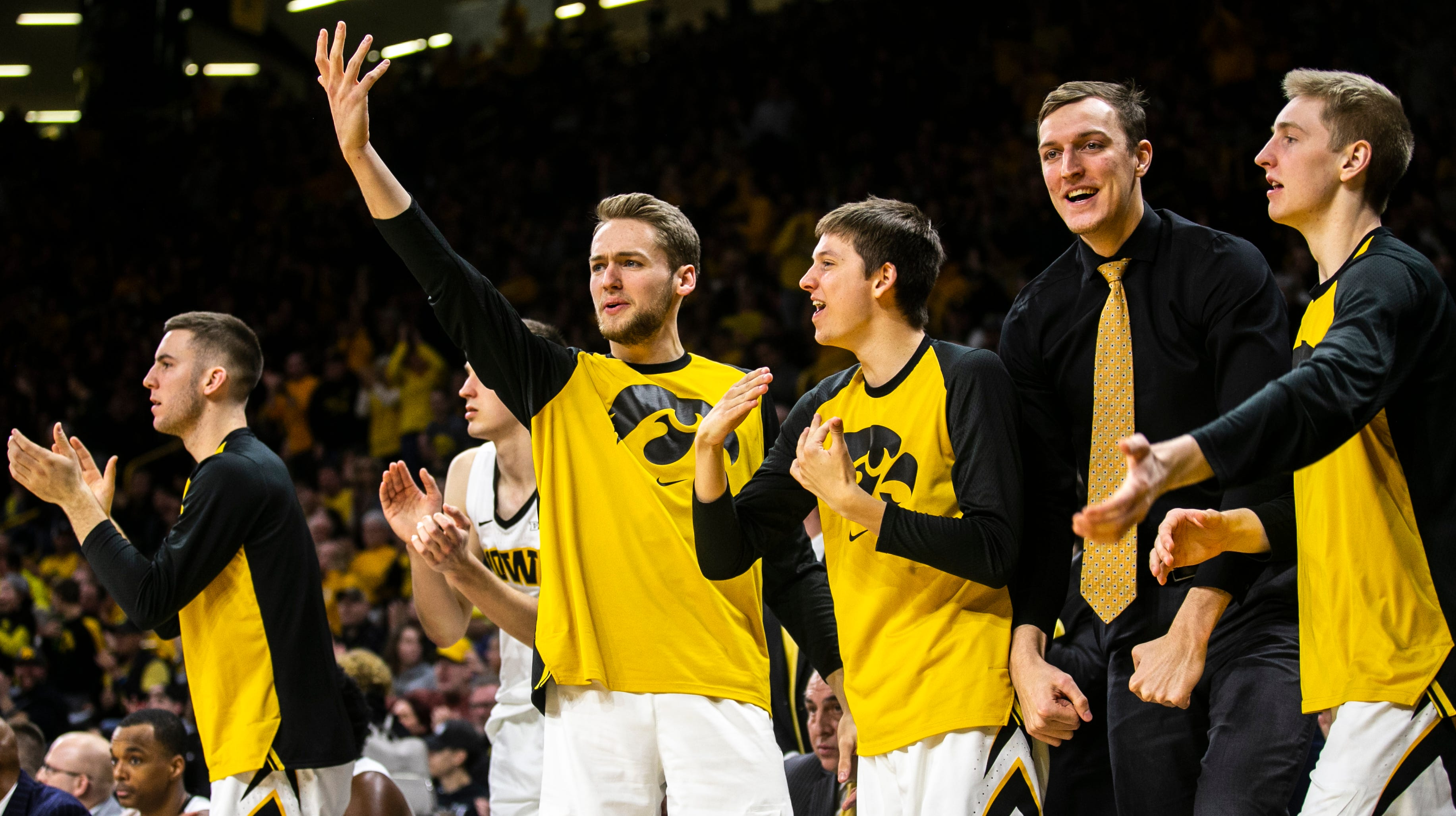 Iowa forward Riley Till (raising hand) celebrates with teammates (from left) Connor McCaffery, Austin Ash, Jack Nunge and Michael Baer during a NCAA Big Ten Conference men's basketball game on Friday, Feb. 1, 2019, at Carver-Hawkeye Arena in Iowa City, Iowa.