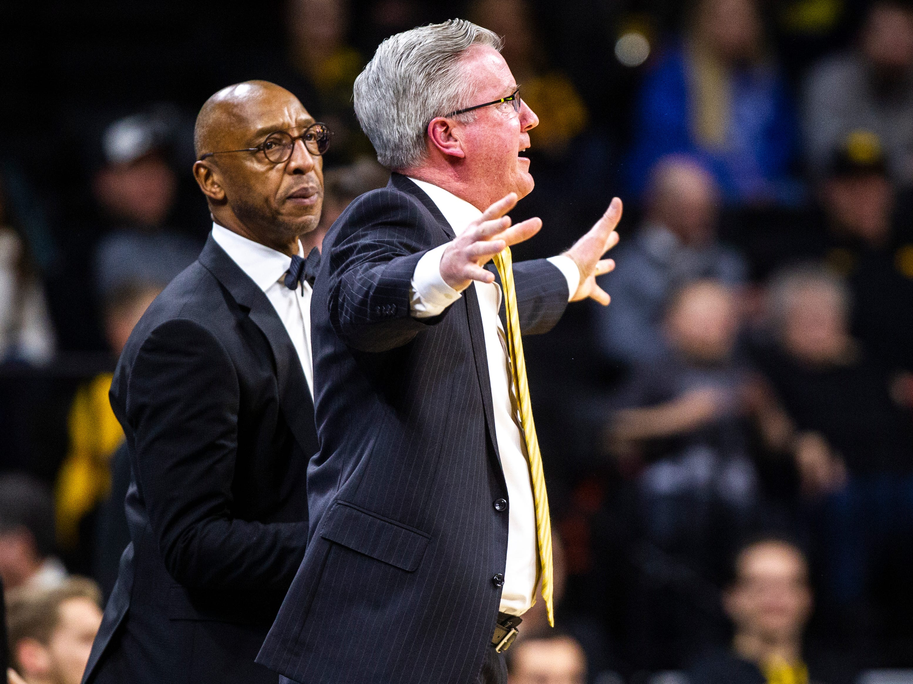 Iowa men's basketball head coach Fran McCaffery calls out while assistant Sherman Dillard, left, looks on during a NCAA Big Ten Conference men's basketball game on Friday, Feb. 1, 2019, at Carver-Hawkeye Arena in Iowa City, Iowa.