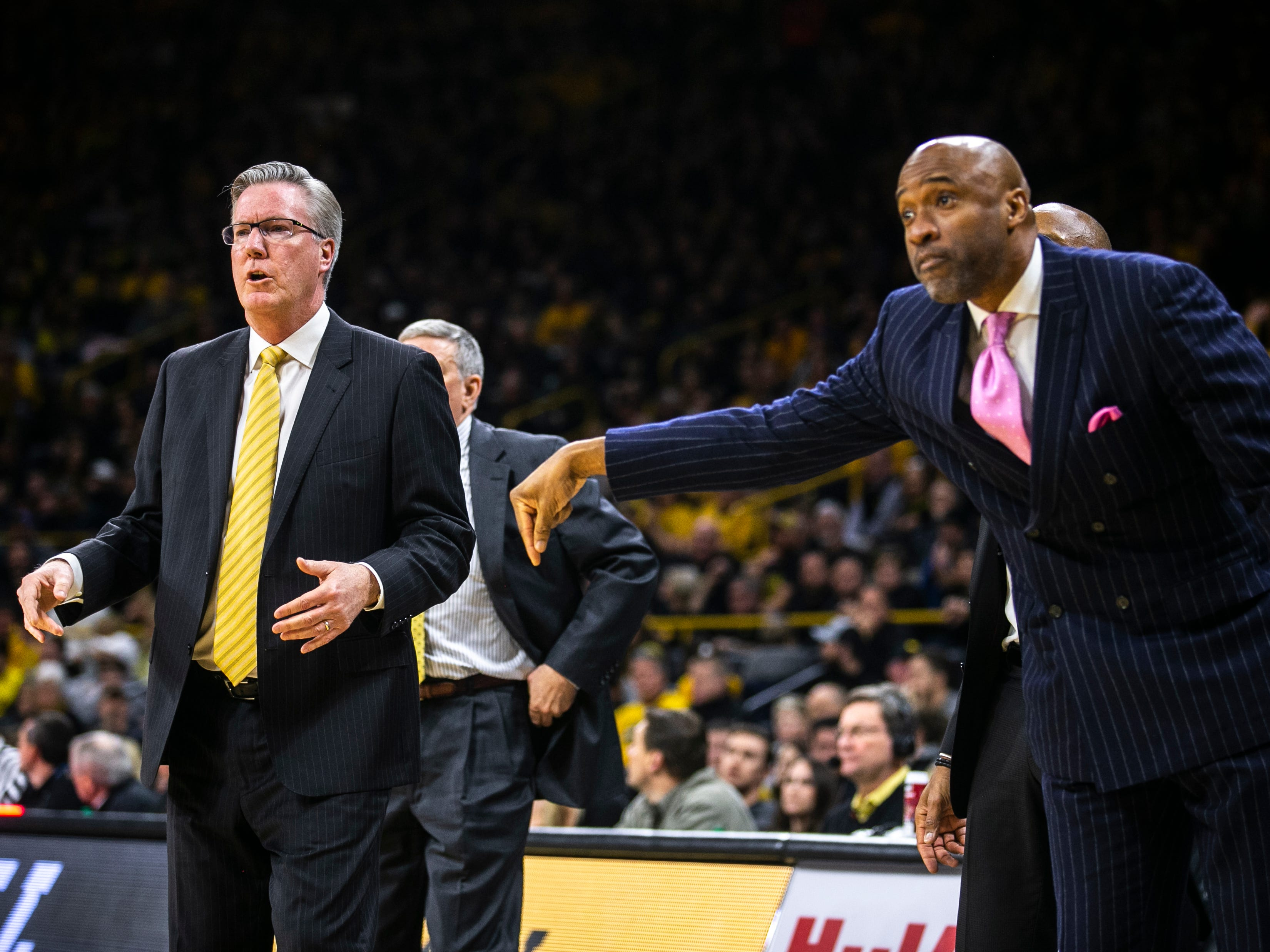 Iowa men's basketball head coach Fran McCaffery, left, and assistant Andrew Francis call out to players during a NCAA Big Ten Conference men's basketball game on Friday, Feb. 1, 2019, at Carver-Hawkeye Arena in Iowa City, Iowa.