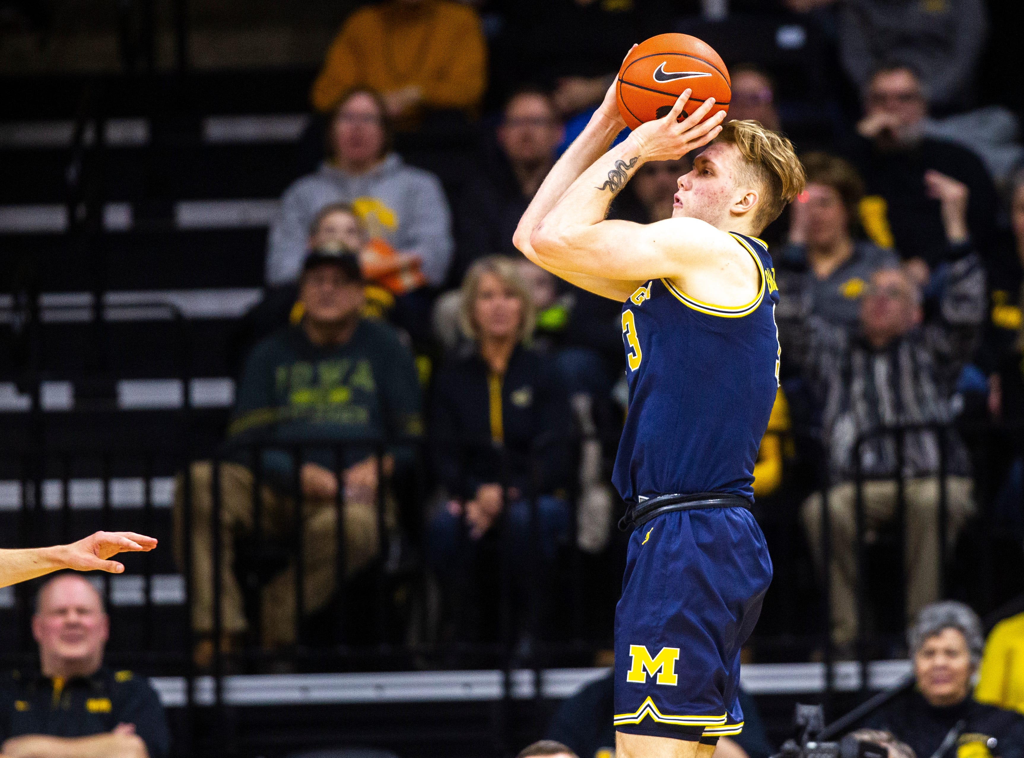 Michigan forward Ignas Brazdeikis (13) shoots a 3-point basket during a NCAA Big Ten Conference men's basketball game on Friday, Feb. 1, 2019, at Carver-Hawkeye Arena in Iowa City, Iowa.
