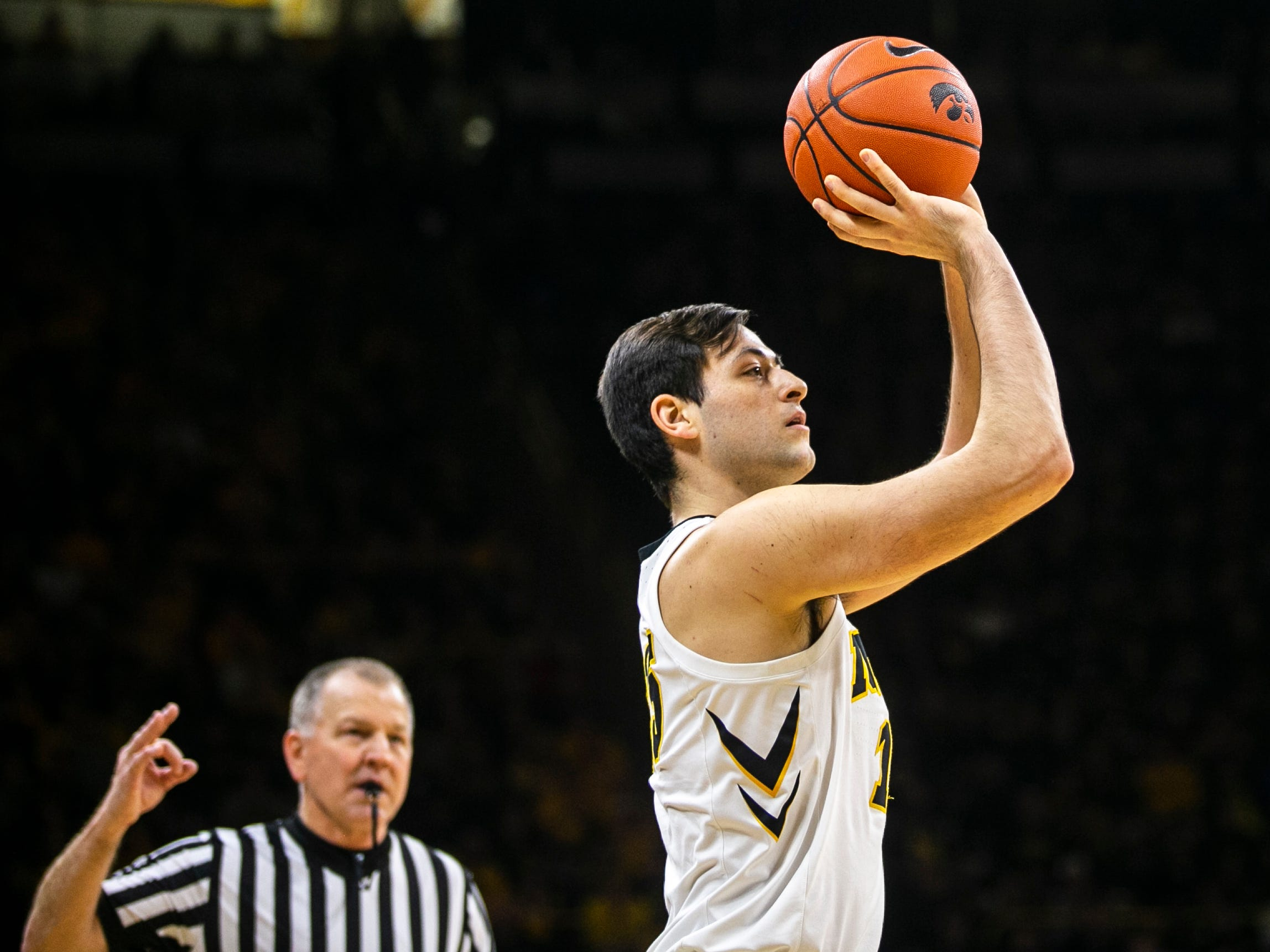 Iowa forward Ryan Kriener (15) shoots a 3-point basket during a NCAA Big Ten Conference men's basketball game on Friday, Feb. 1, 2019, at Carver-Hawkeye Arena in Iowa City, Iowa.