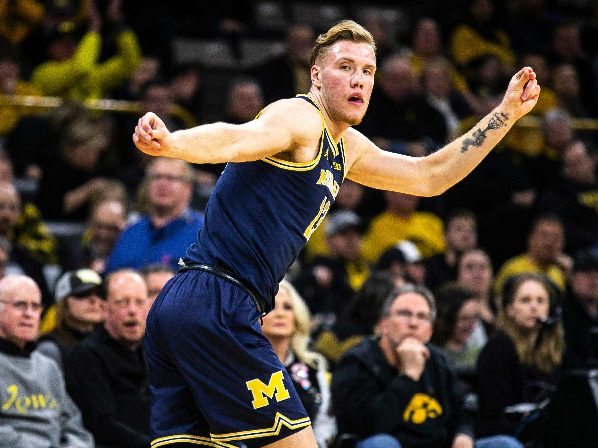 Michigan forward Ignas Brazdeikis (13) runs up court during a NCAA Big Ten Conference men's basketball game on Friday, Feb. 1, 2019, at Carver-Hawkeye Arena in Iowa City, Iowa.