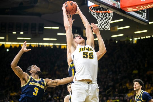 Iowa center Luka Garza powers up for two of his 19 points in an upset win over No. 5 Michigan on Friday at soldout Carver-Hawkeye Arena.