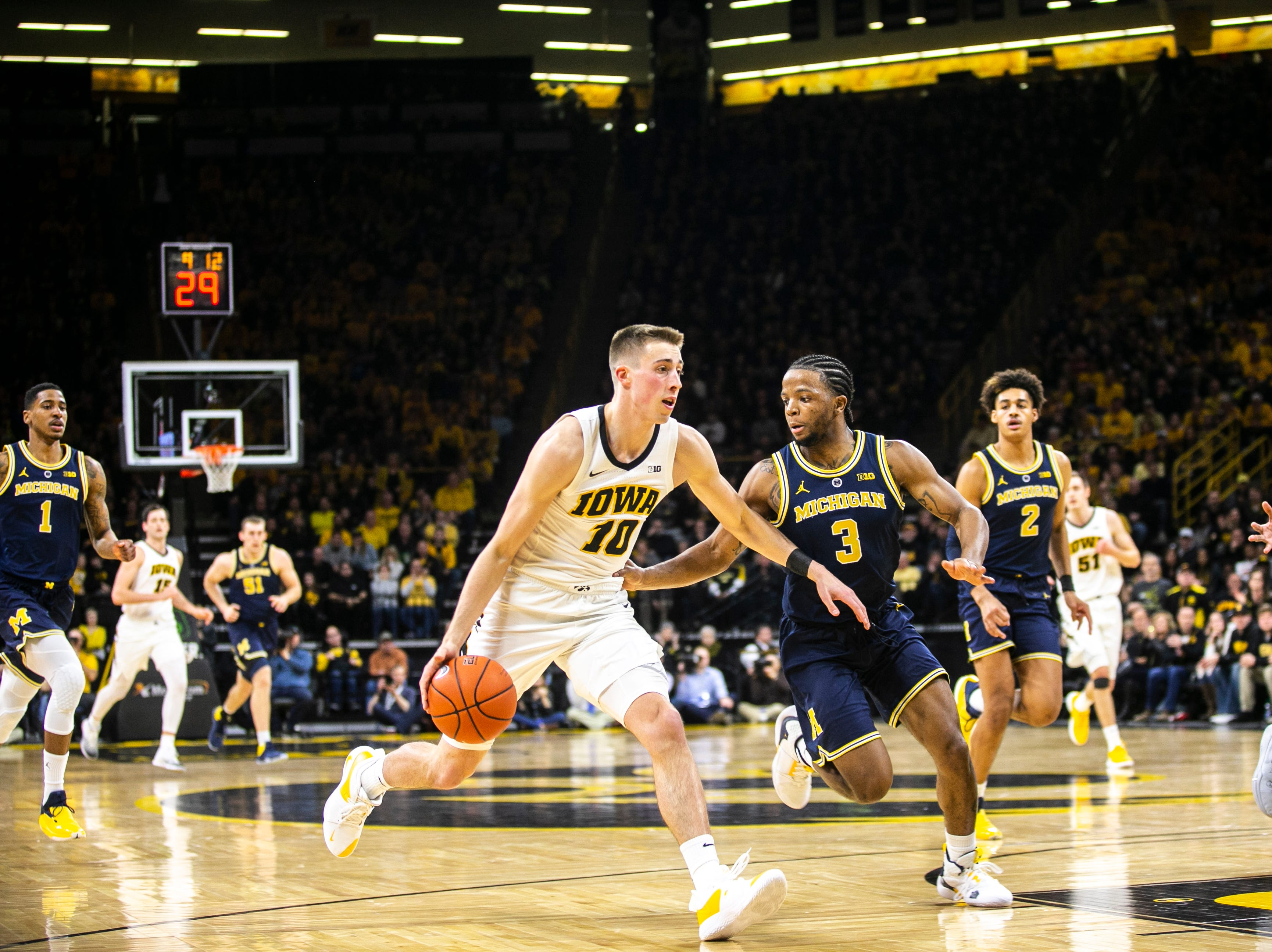 Iowa guard Joe Wieskamp (10) drives to the hoop past Michigan guard Zavier SImpson (3) after getting a steal during a NCAA Big Ten Conference men's basketball game on Friday, Feb. 1, 2019, at Carver-Hawkeye Arena in Iowa City, Iowa.