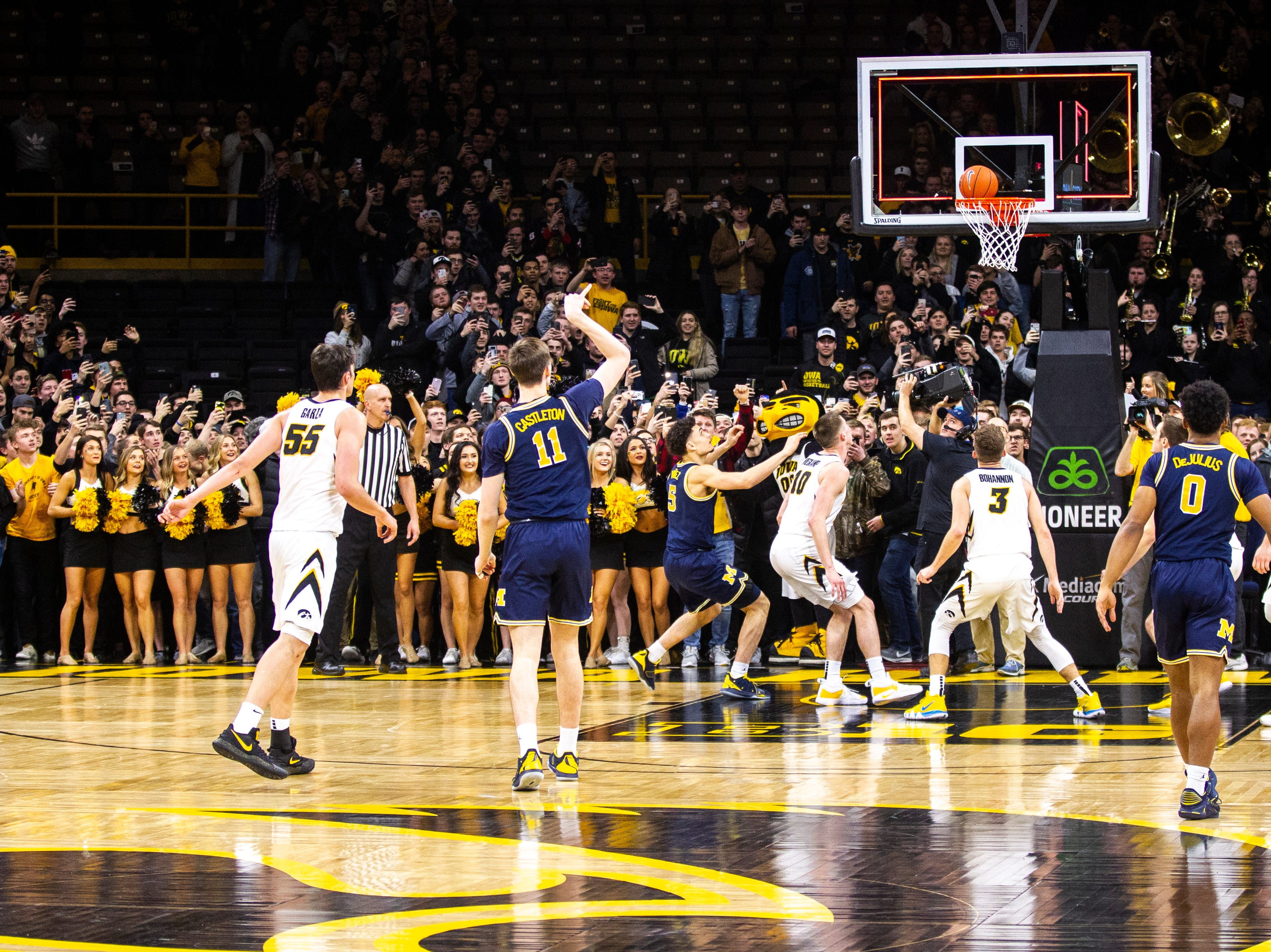 Michigan forward Colin Castleton (11) misses a 3-point basket at the buzzer during a NCAA Big Ten Conference men's basketball game on Friday, Feb. 1, 2019, at Carver-Hawkeye Arena in Iowa City, Iowa. The Hawkeyes defeated Michigan's Wolverines, 74-59.