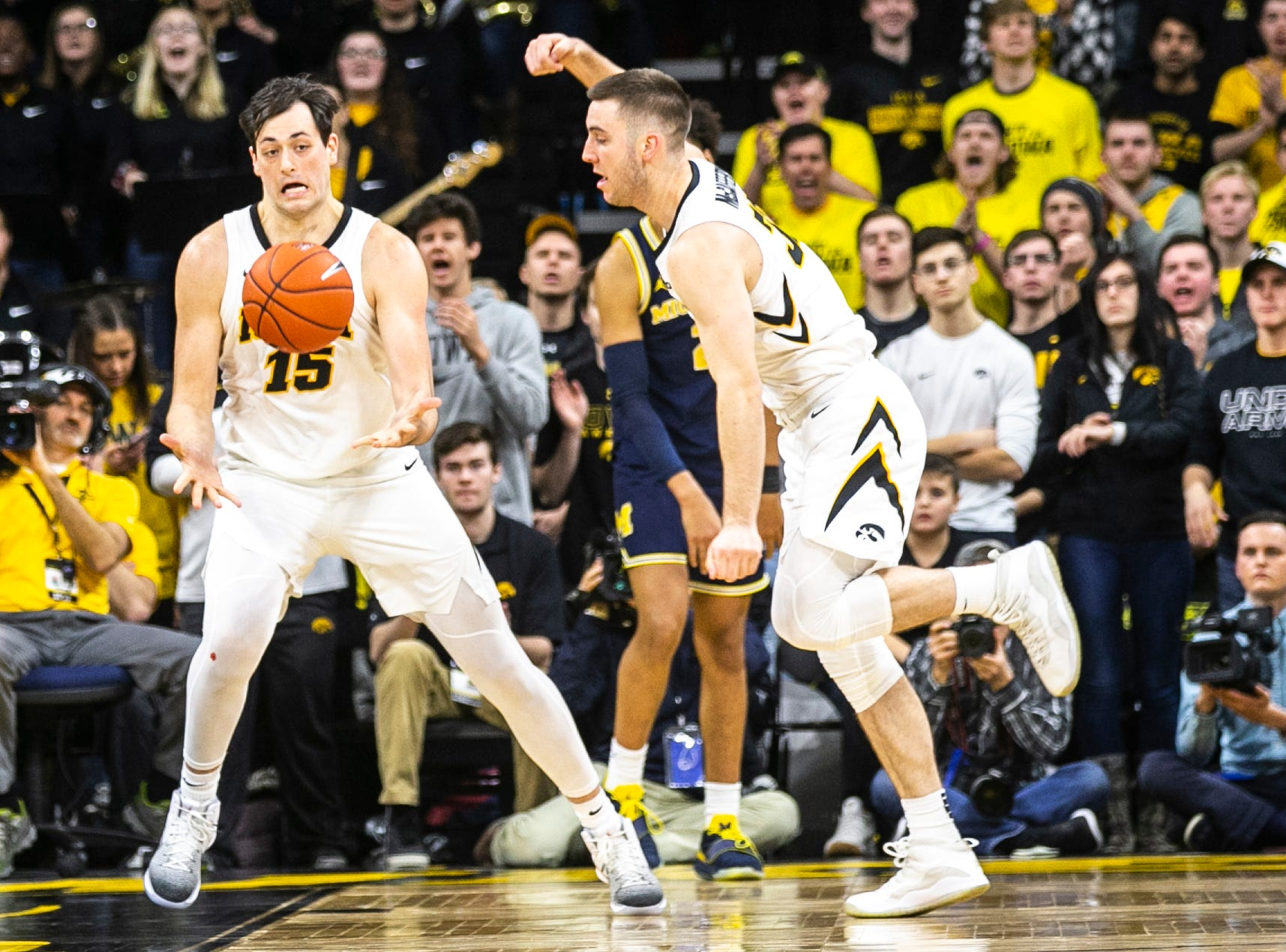 Iowa forward Ryan Kriener (15) grabs a rebound next to Connor McCaffery, right, during a NCAA Big Ten Conference men's basketball game on Friday, Feb. 1, 2019, at Carver-Hawkeye Arena in Iowa City, Iowa.