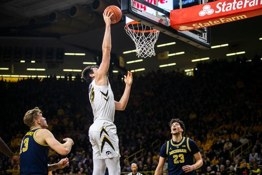 Iowa center Ryan Kriener, here scoring against Michigan on Friday, cautions fans to overlook Indiana's recent seven-game losing streak. He says the Hoosiers that the Hawkeyes are facing Thursday are back to full health and resemble the team that got off to a 12-2 start.