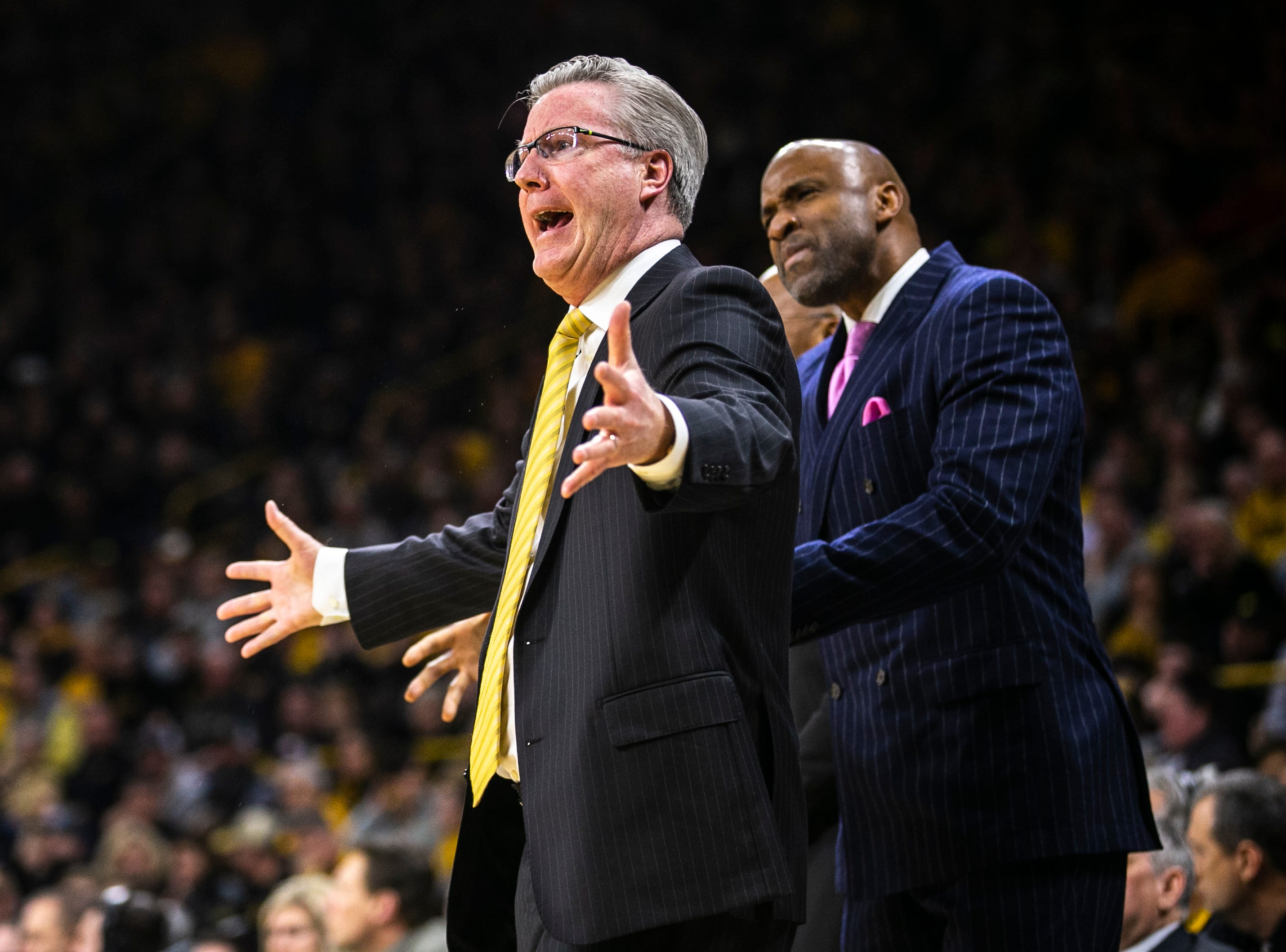 Iowa men's basketball head coach Fran McCaffery calls out while assistant Andrew Francis looks on during a NCAA Big Ten Conference men's basketball game on Friday, Feb. 1, 2019, at Carver-Hawkeye Arena in Iowa City, Iowa.