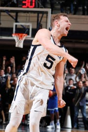 Butler Bulldogs guard Paul Jorgensen (5) reacts after making a three point shot against the Seton Hall Pirates during the first half at Hinkle Fieldhouse.