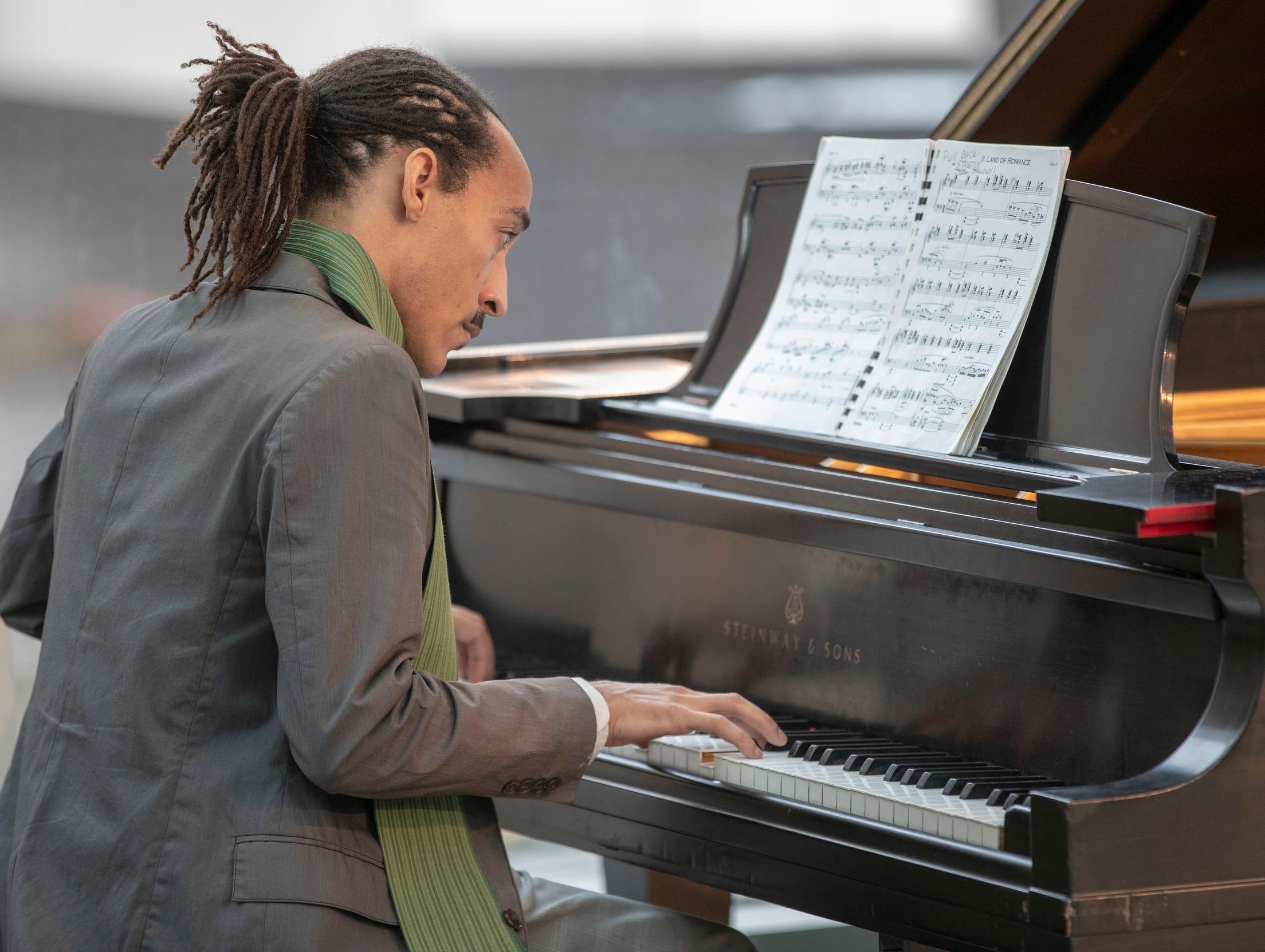 Joshua Thompson plays piano during the 2019 Art and Soul kickoff celebration at the Indianapolis Arts Garden, Indianapolis, Saturday, Feb. 2, 2019.