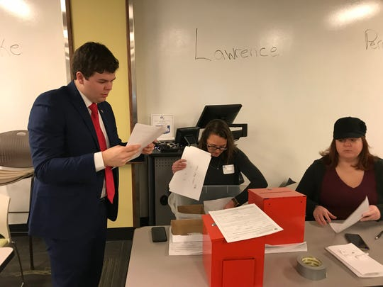 Paul Annee, left, looks over paperwork after gaining the Marion County Republican Party endorsement in a south-side City-County Council race on Feb. 2.