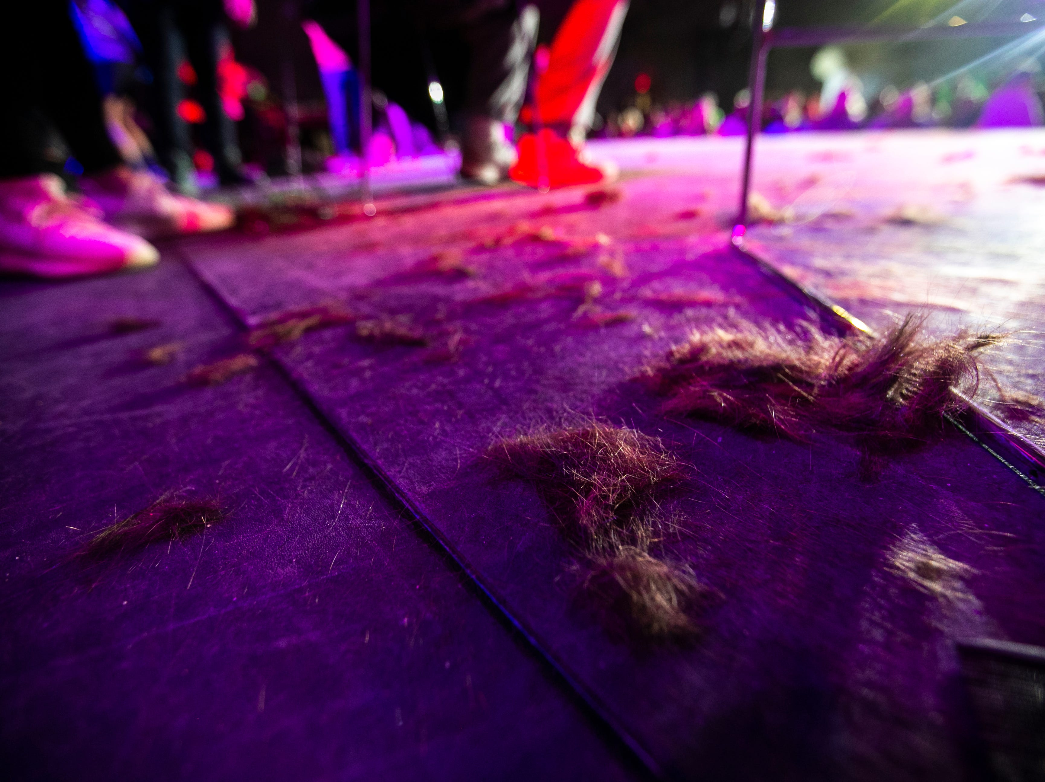 "Hair sits on the stage after the ""Short Hair, Don't Care"" haircutting event during the University of Iowa Dance Marathon 25 on Saturday, Feb. 2, 2019, at the Iowa Memorial Union in Iowa City, Iowa."