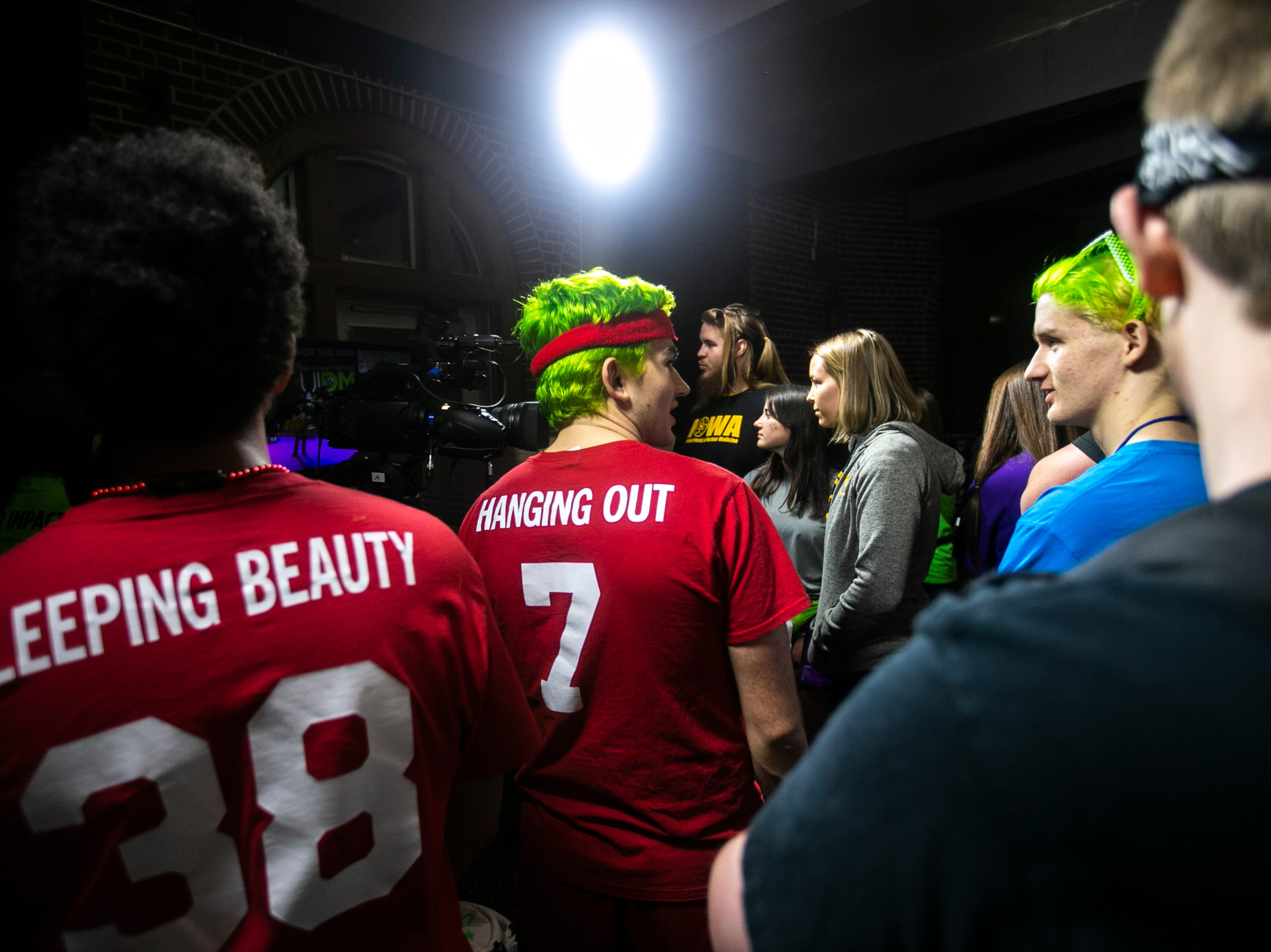 Landan Paulsen, back center, stands with other members students while they wait to get their hair cut during the University of Iowa Dance Marathon 25 on Saturday, Feb. 2, 2019, at the Iowa Memorial Union in Iowa City, Iowa.
