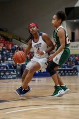 Jackson State Christina Ellis drives past a Mississippi Valley State defender during a game Saturday, Feb. 2, 2019, at the Lee E. Williams Athletic and Assembly Center.