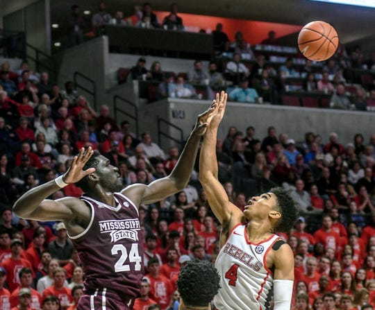 Mississippi State forward Abdul Ado (24) blocks a shot by Mississippi guard Breein Tyree (4) during the second half of an NCAA college basketball game in Oxford, Miss., Saturday, Feb. 2, 2019. (Bruce Newman/The Oxford Eagle via AP)