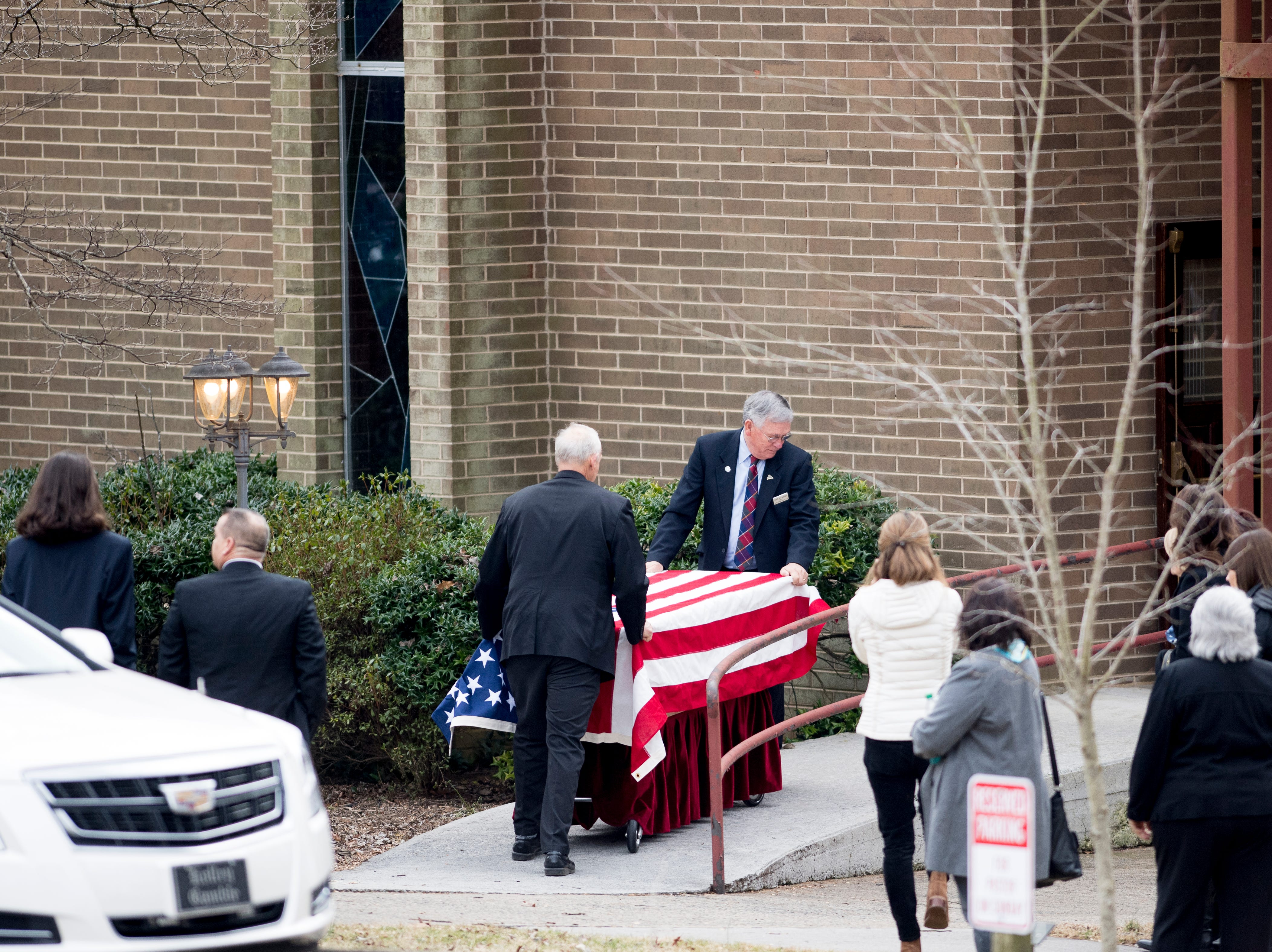 Pallbearers bring the casket of Rosemary Mariner, the US Navy's first female fighter pilot, into Norris United Methodist Church in Norris, Tennessee on Saturday, February 2, 2019. Mariner died January 24th of cancer.