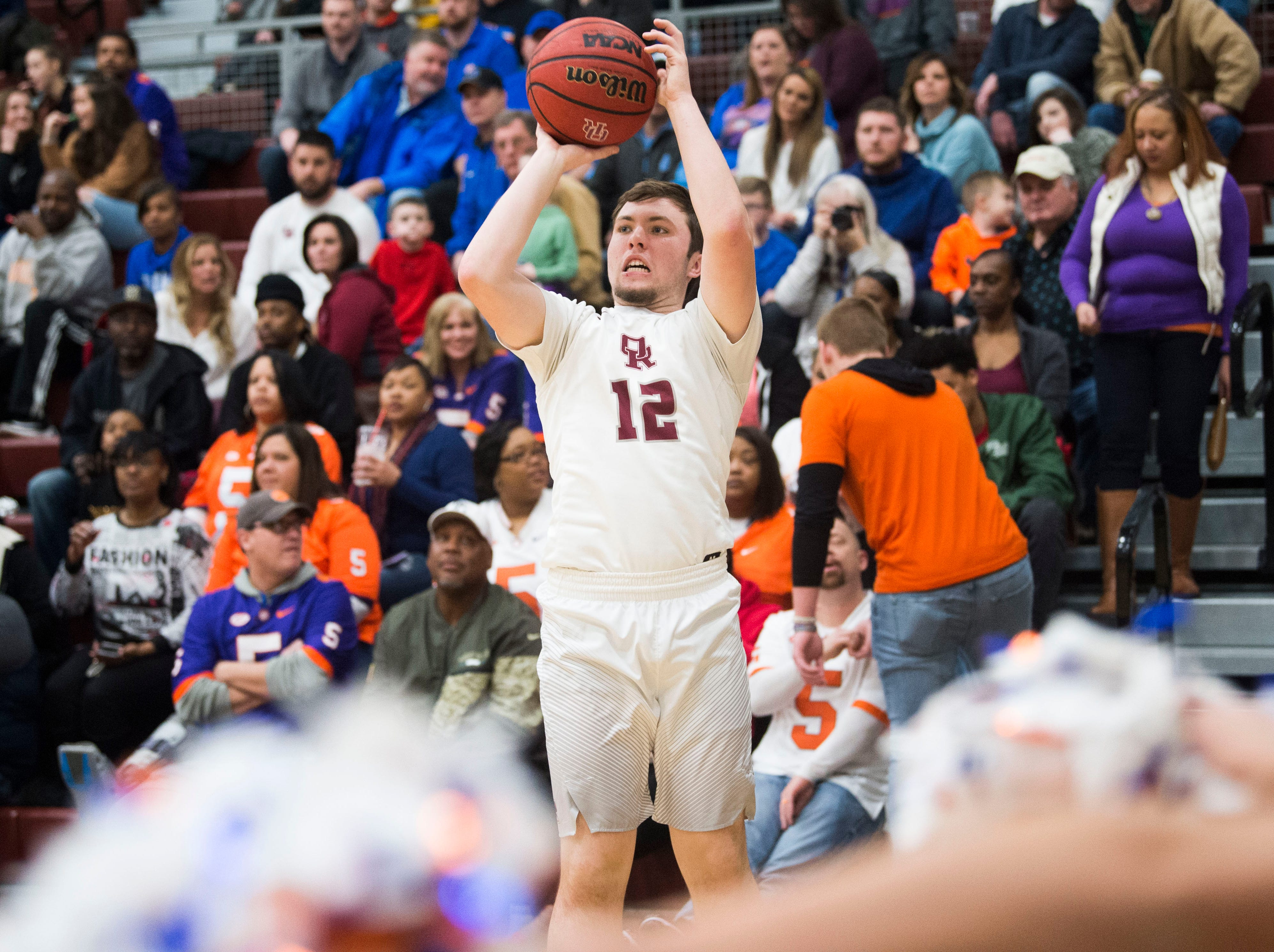Oak Ridge's Joe Kesterson (12) takes a shot during a high school basketball game between Oak Ridge and Campbell County at Oak Ridge Friday, Feb. 1, 2019.