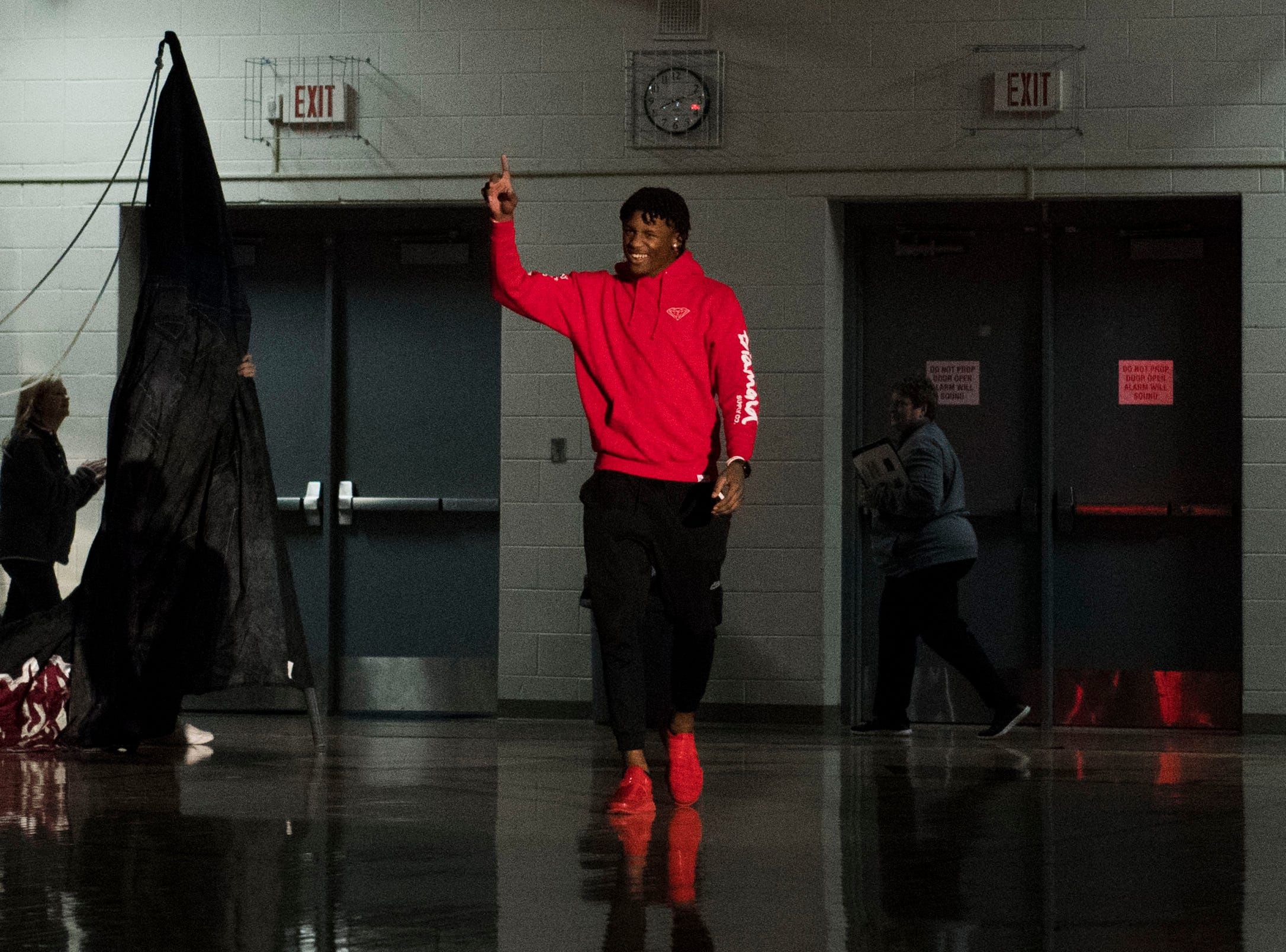 Former Oak Ridge High School athlete Tee Higgins, now a wide receiver at Clemson University, returns to the court for his jersey to be retired, during a high school basketball game between Oak Ridge and Campbell County at Oak Ridge Friday, Feb. 1, 2019.