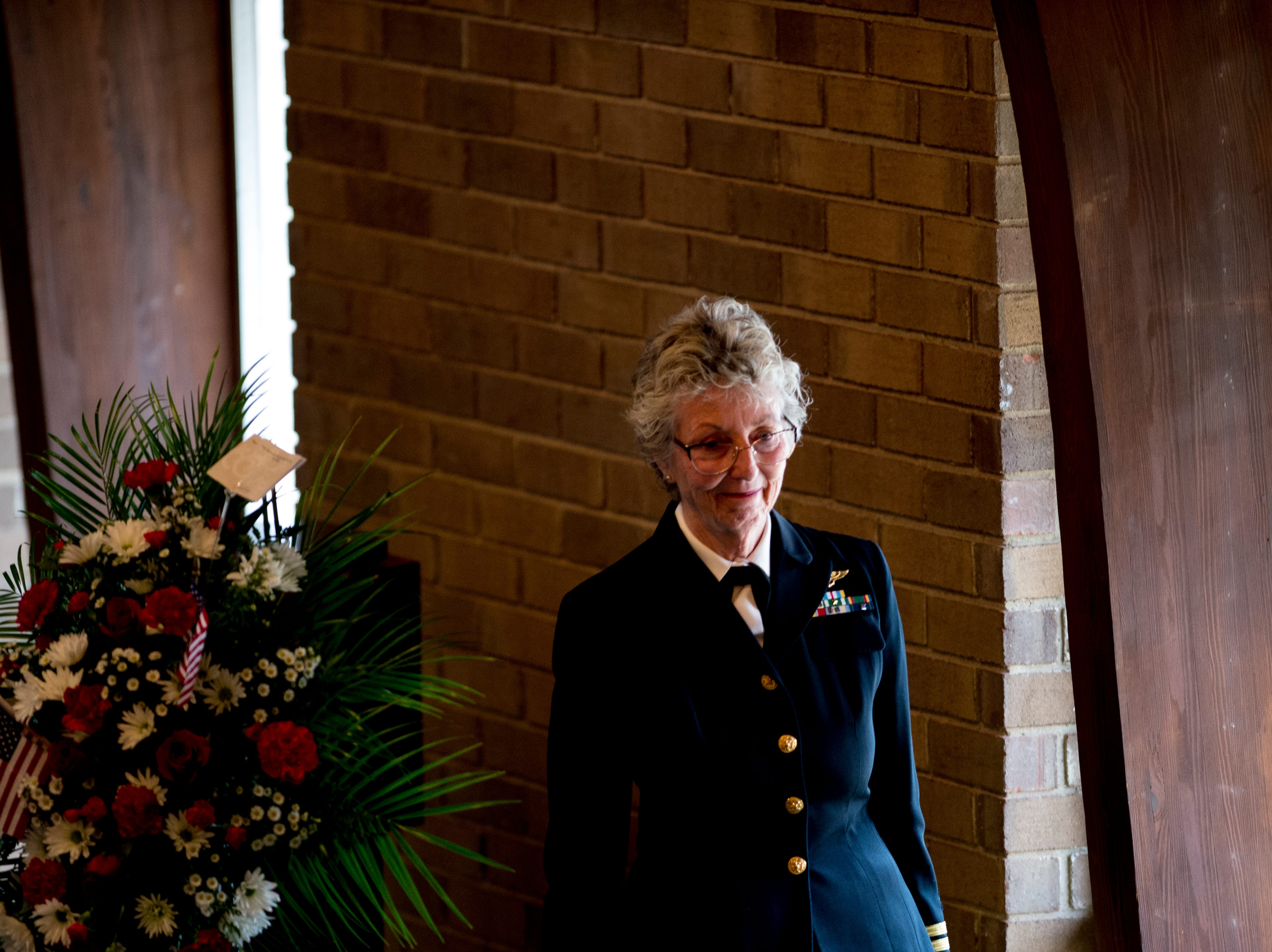 US Navy Captain Mary Louise Jorgenson Griffon, retired, walks off the stage after giving a speech during a funeral service for Rosemary Mariner, the US Navy's first female fighter pilot, at Norris United Methodist Church in Norris, Tennessee on Saturday, February 2, 2019. Mariner died January 24th of cancer.