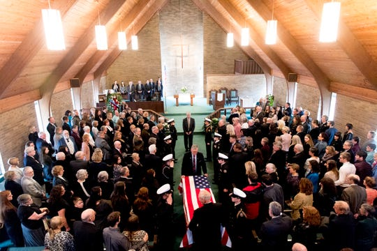 Pallbearers carry the casket of Rosemary Mariner, the US Navy's first female fighter pilot, during a funeral service at Norris United Methodist Church in Norris, Tennessee on Saturday, February 2, 2019. Mariner died January 24th of cancer.