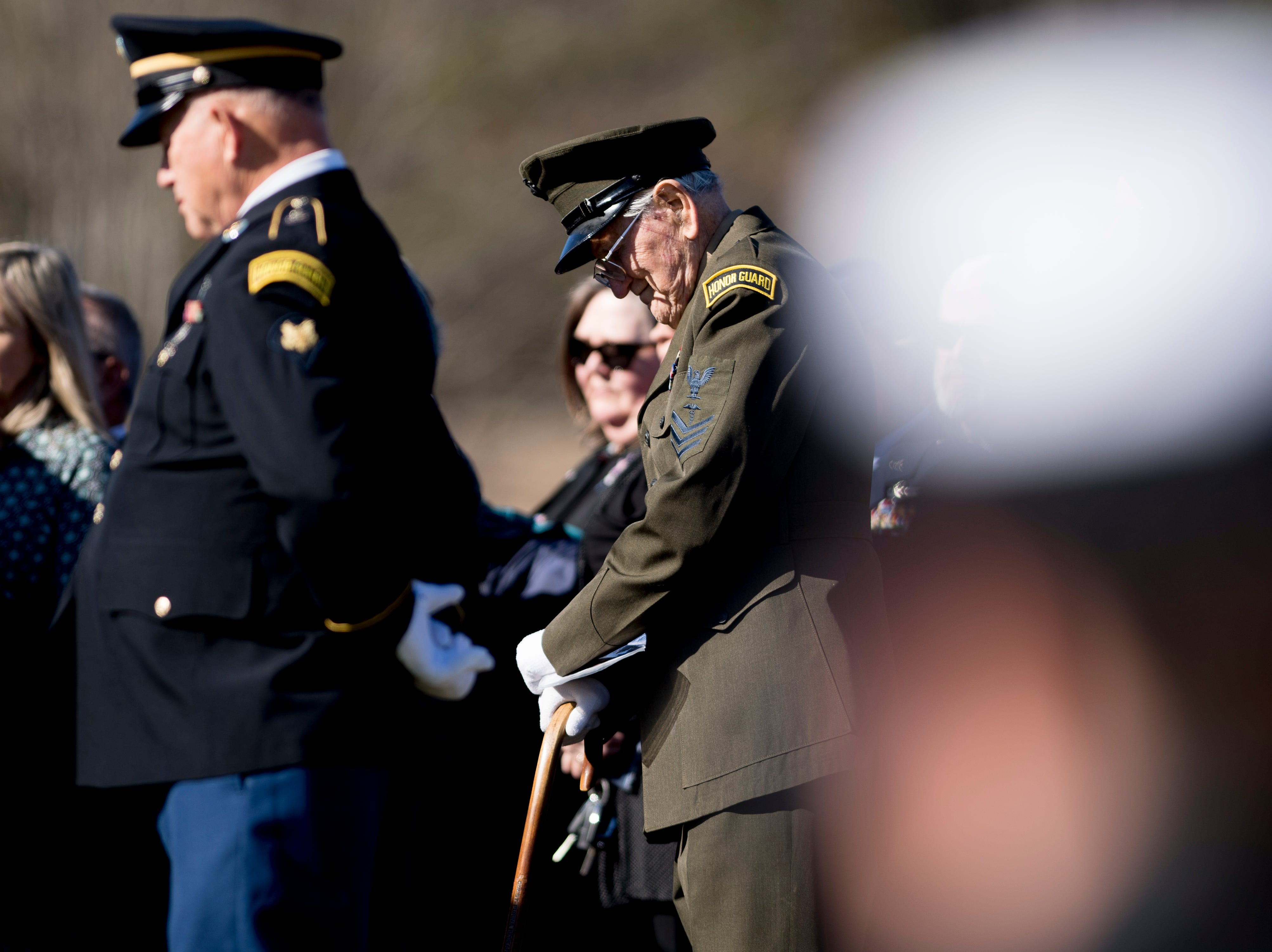 An honor guard member bows their head in prayer during a graveside service for Rosemary Mariner, the US Navy's first female fighter pilot, at New Loyston Cemetery in Maynardville, Tennessee on Saturday, February 2, 2019. Mariner died January 24th of cancer.
