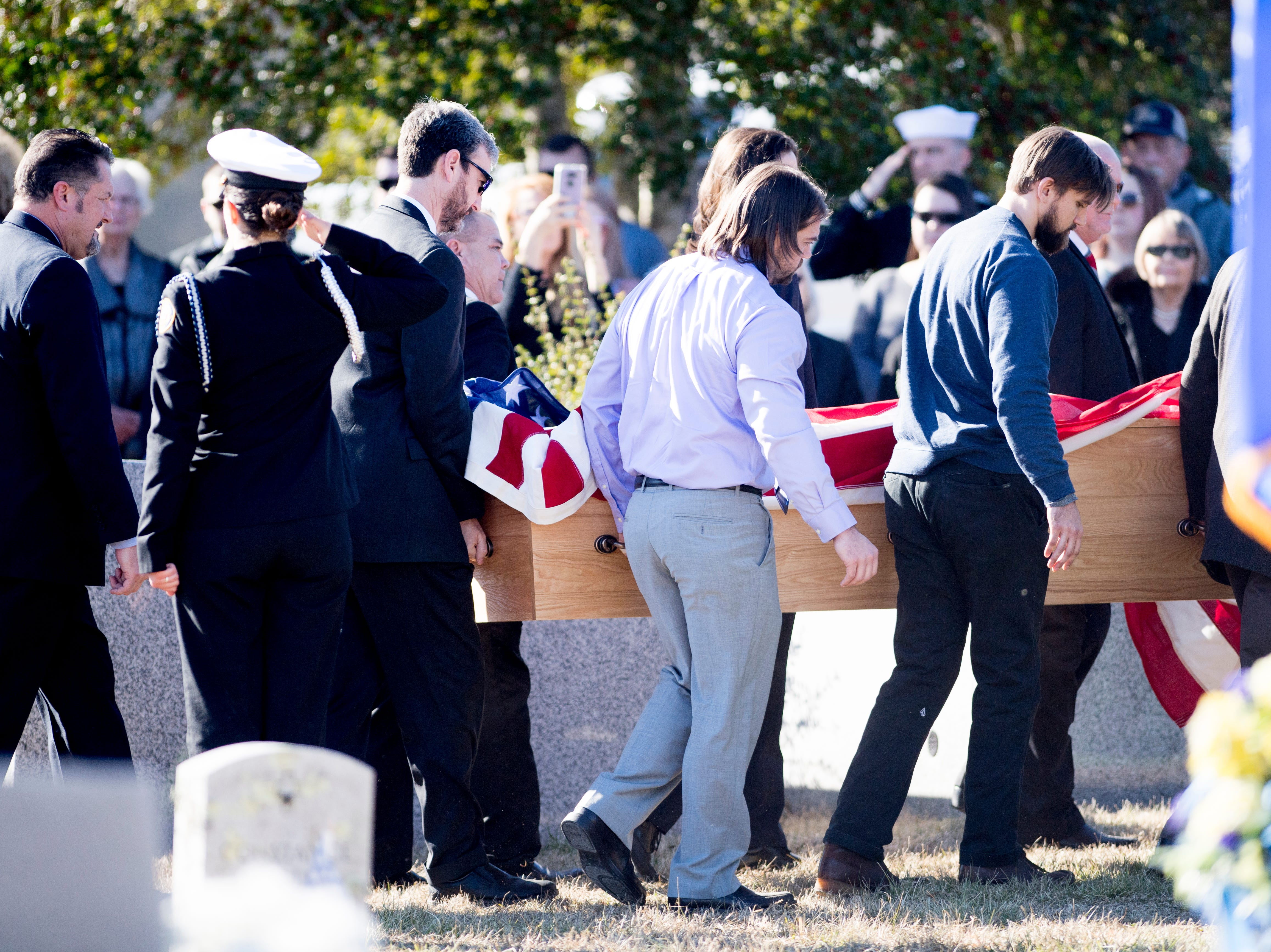 Pallbearers carry the casket of Rosemary Mariner, the US Navy's first female fighter pilot, from the hearse during a graveside service at New Loyston Cemetery in Maynardville, Tennessee on Saturday, February 2, 2019. Mariner died January 24th of cancer.