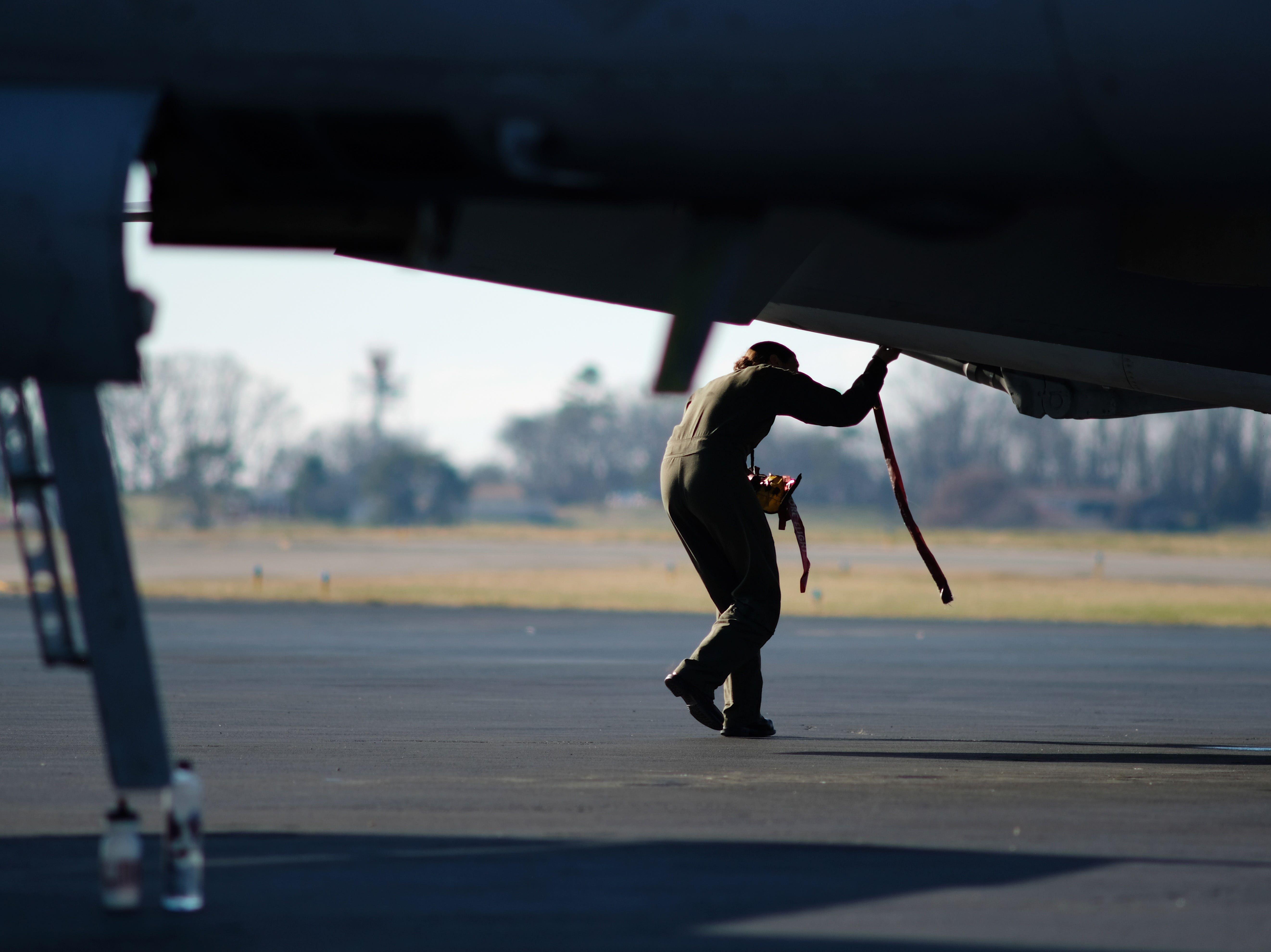 "Navy pilot LCDR Jennifer ""Cujo"" Hesling makes adjustments to her F/A18 after returning from a flyover at the funeral of Rosemary Mariner, the Navy's first female fighter pilot, on Saturday, Feb. 2, 2019 at Knoxville's McGhee Tyson Airport."