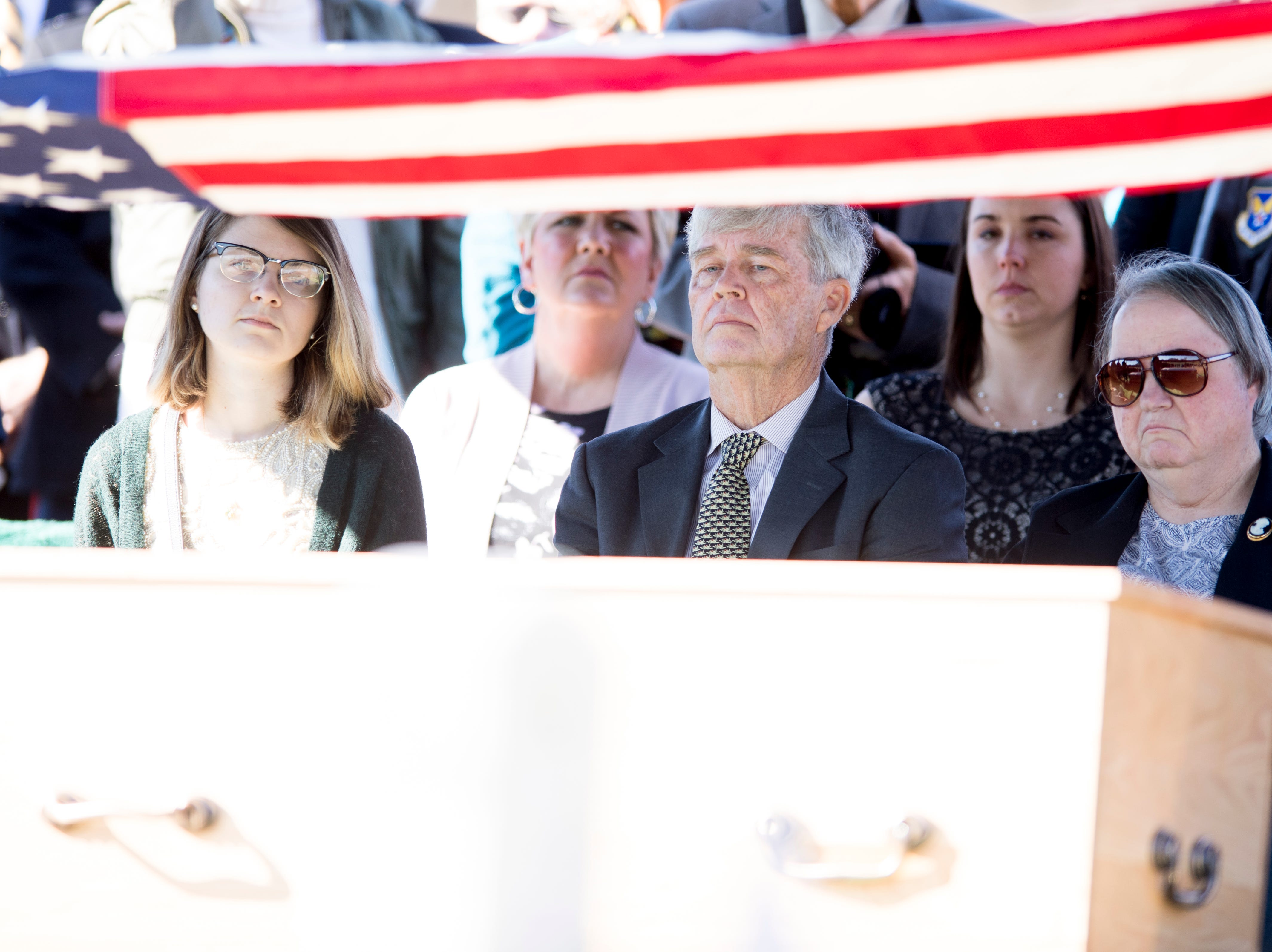 From left, Emmalee Mariner, daughter of Rosemary Mariner, the US Navy's first female fighter pilot, Tommy Mariner, husband of Rosemary, and Libby Merims, sister of Rosemary, listen during a graveside service at New Loyston Cemetery in Maynardville, Tennessee on Saturday, February 2, 2019. Mariner died January 24th of cancer.