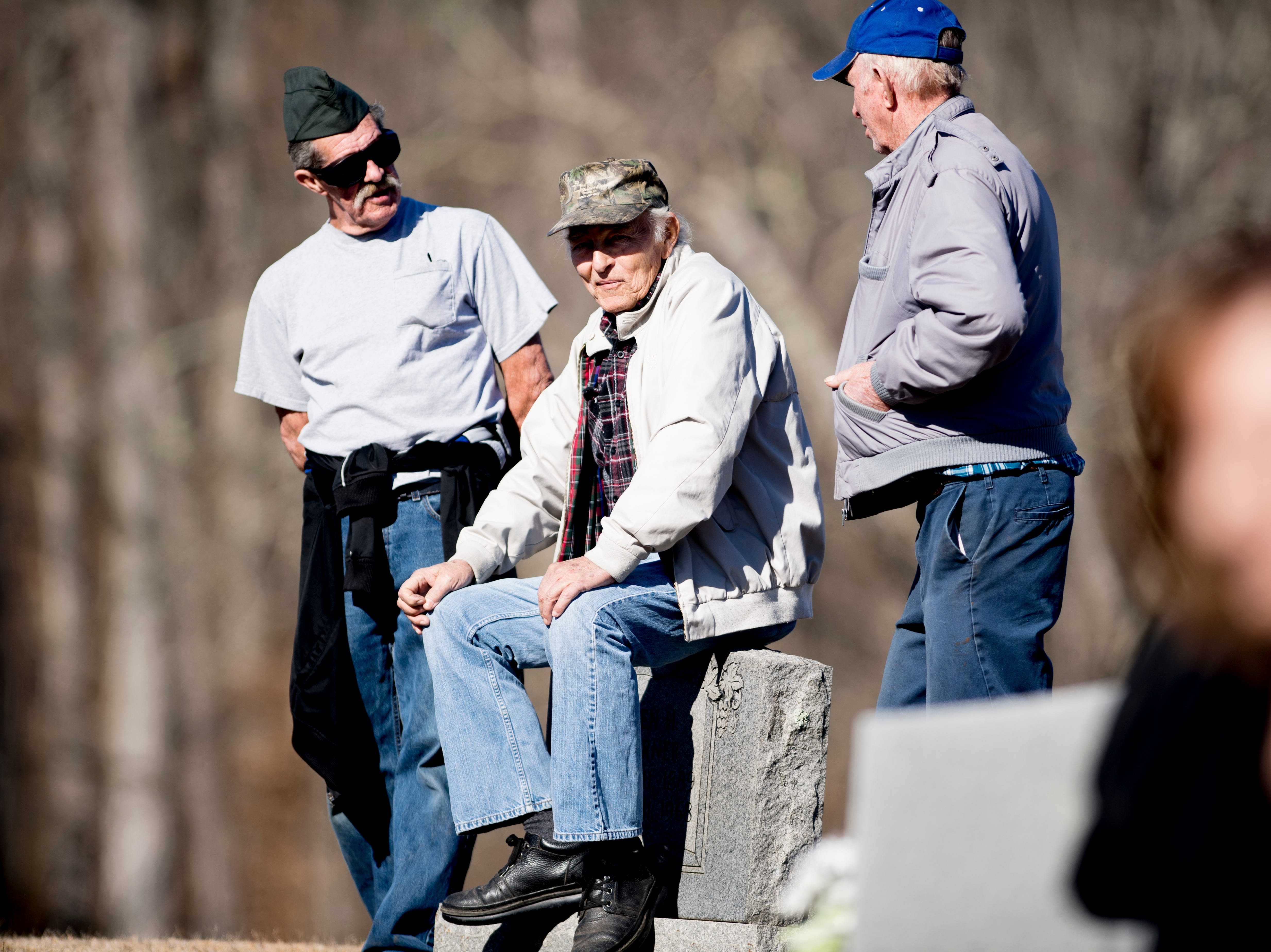 Veterans mingle before a graveside service for Rosemary Mariner, the US Navy's first female fighter pilot, at New Loyston Cemetery in Maynardville, Tennessee on Saturday, February 2, 2019. Mariner died January 24th of cancer.