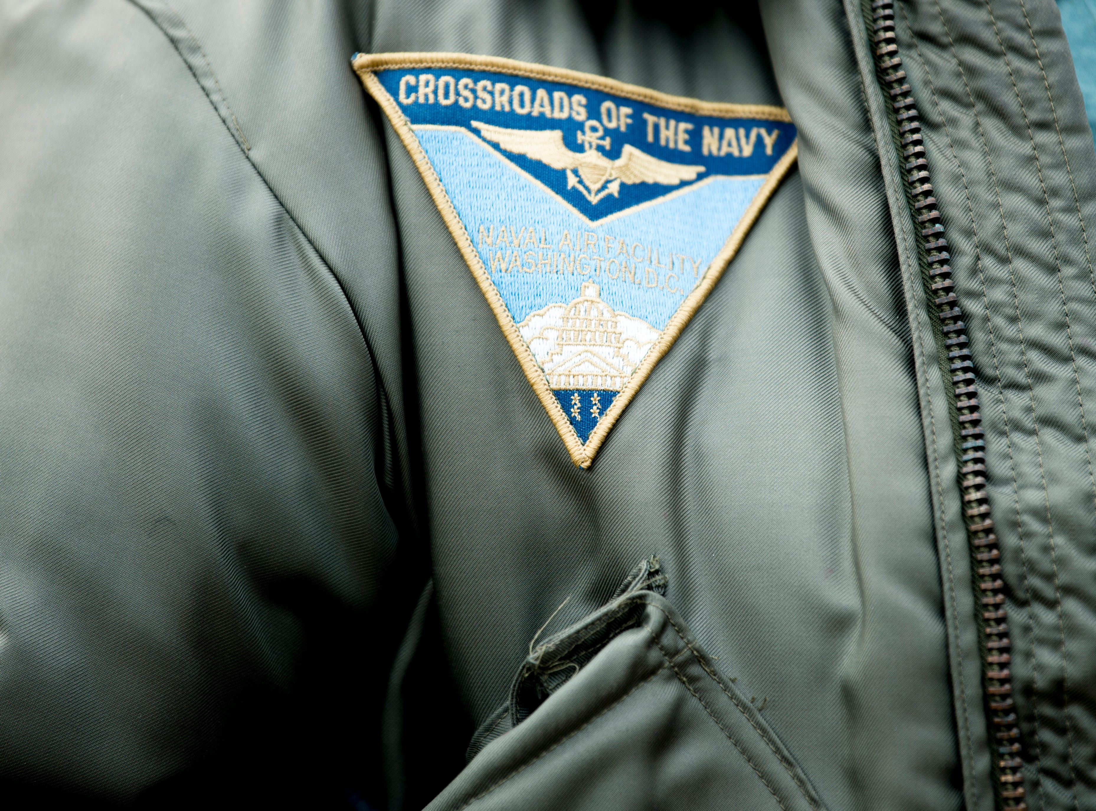 "Chris Giza, the second female fighter pilot in the Navy, wears a ""Crossroads of the Navy"" patch on her jacket during a funeral service for Rosemary Mariner, the US Navy's first female fighter pilot, at Norris United Methodist Church in Norris, Tennessee on Saturday, February 2, 2019. Mariner died January 24th of cancer."