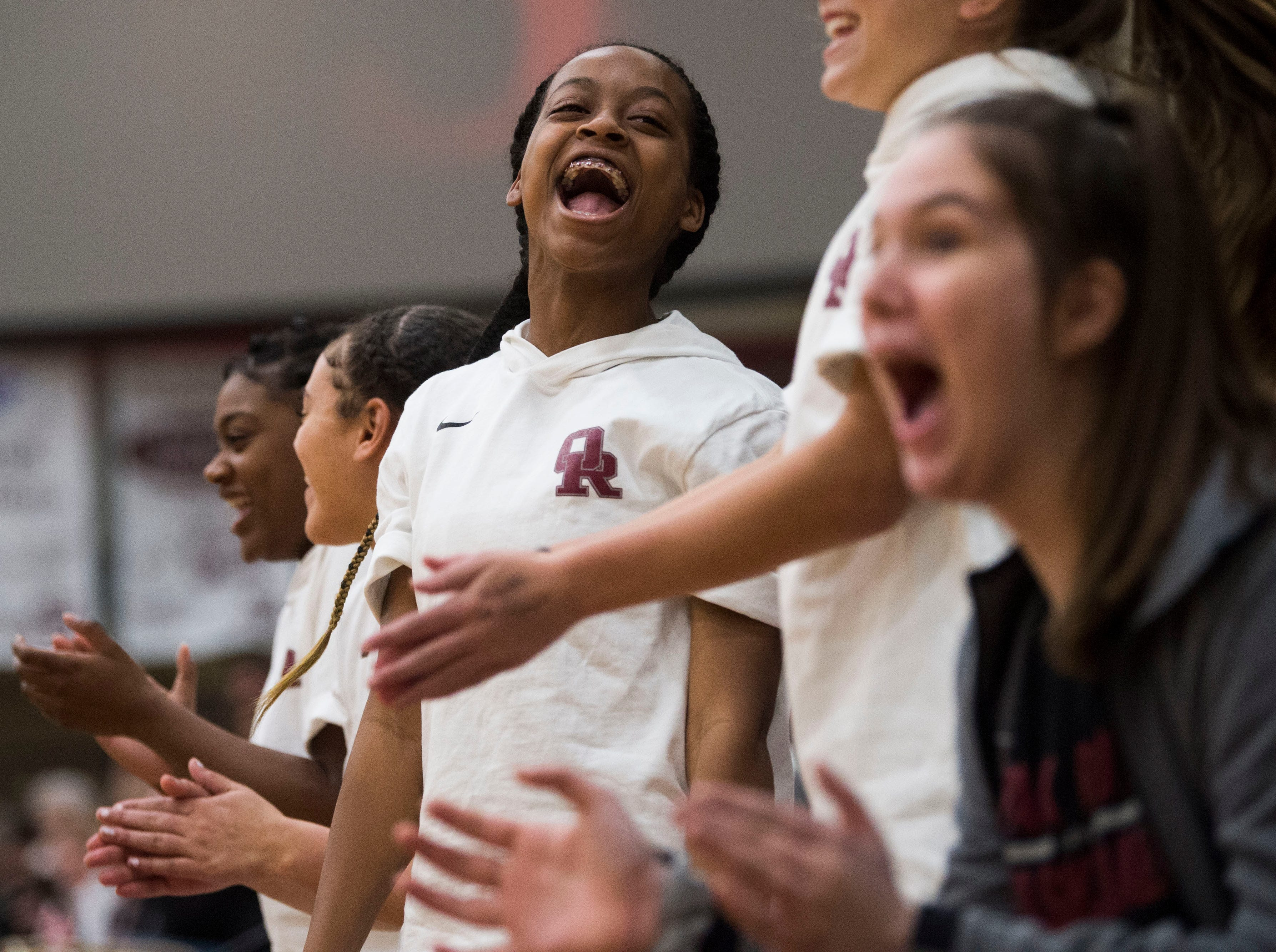 Oak Ridge's Semaj Clark celebrates on the bench during a high school basketball game between Oak Ridge and Campbell County at Oak Ridge Friday, Feb. 1, 2019.