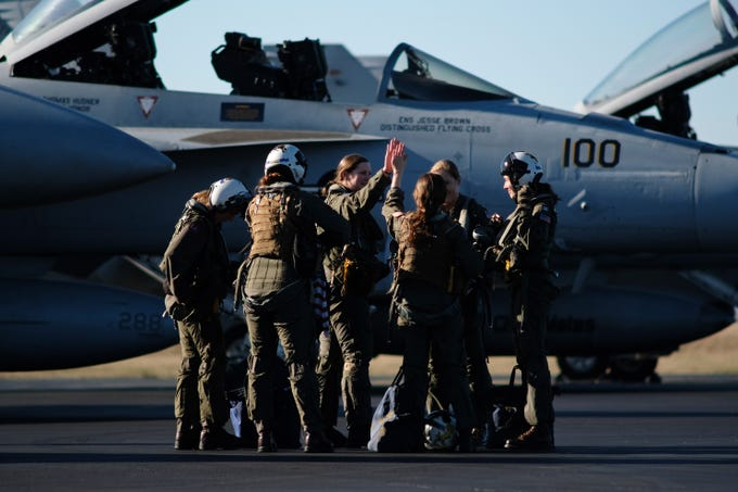A group of all female Navy pilot greet each other after returning from a flyover at the funeral of Rosemary Mariner, the Navy's first female fighter pilot, on Saturday, Feb. 2, 2019 at Knoxville's McGhee Tyson Airport.