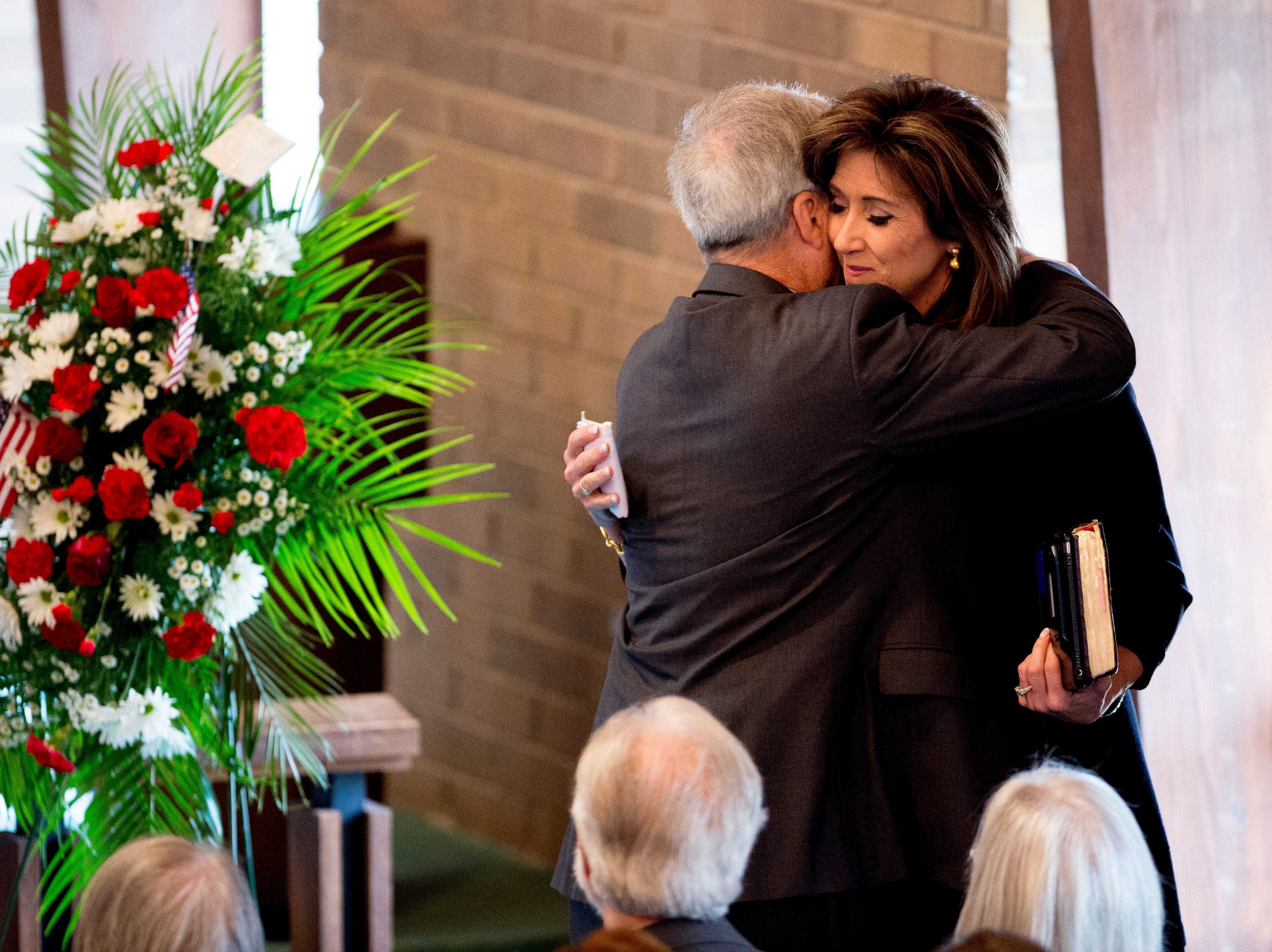 US Navy Lieutenant Commander Tammy Jo Shults hugs Tommy Mariner, husband of Rosemary Mariner, the US Navy's first female fighter pilot, during a funeral service for his wife at Norris United Methodist Church in Norris, Tennessee on Saturday, February 2, 2019. Mariner died January 24th of cancer.
