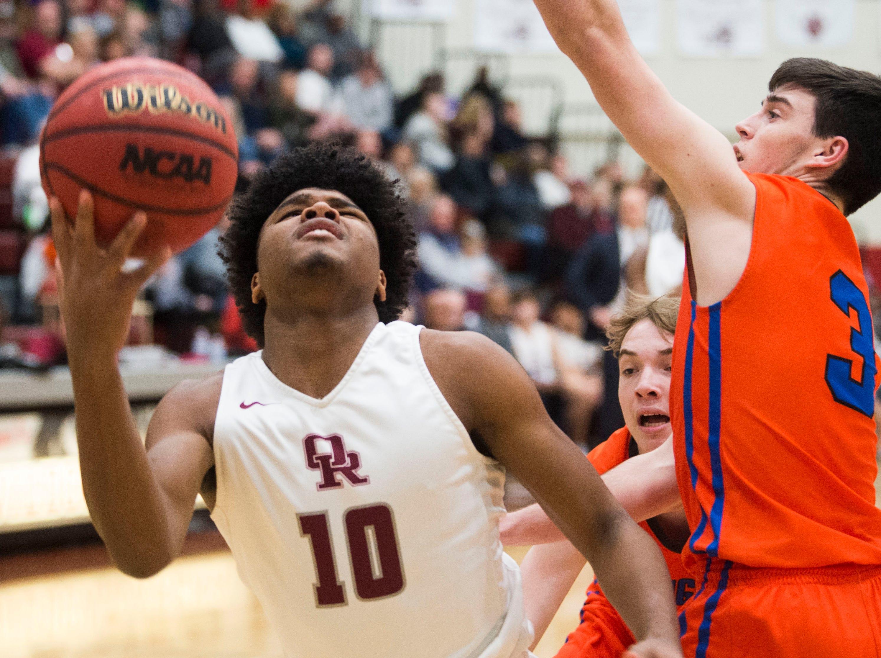 Oak Ridge's Herbert Booker (10) takes a shot during a high school basketball game between Oak Ridge and Campbell County at Oak Ridge Friday, Feb. 1, 2019.