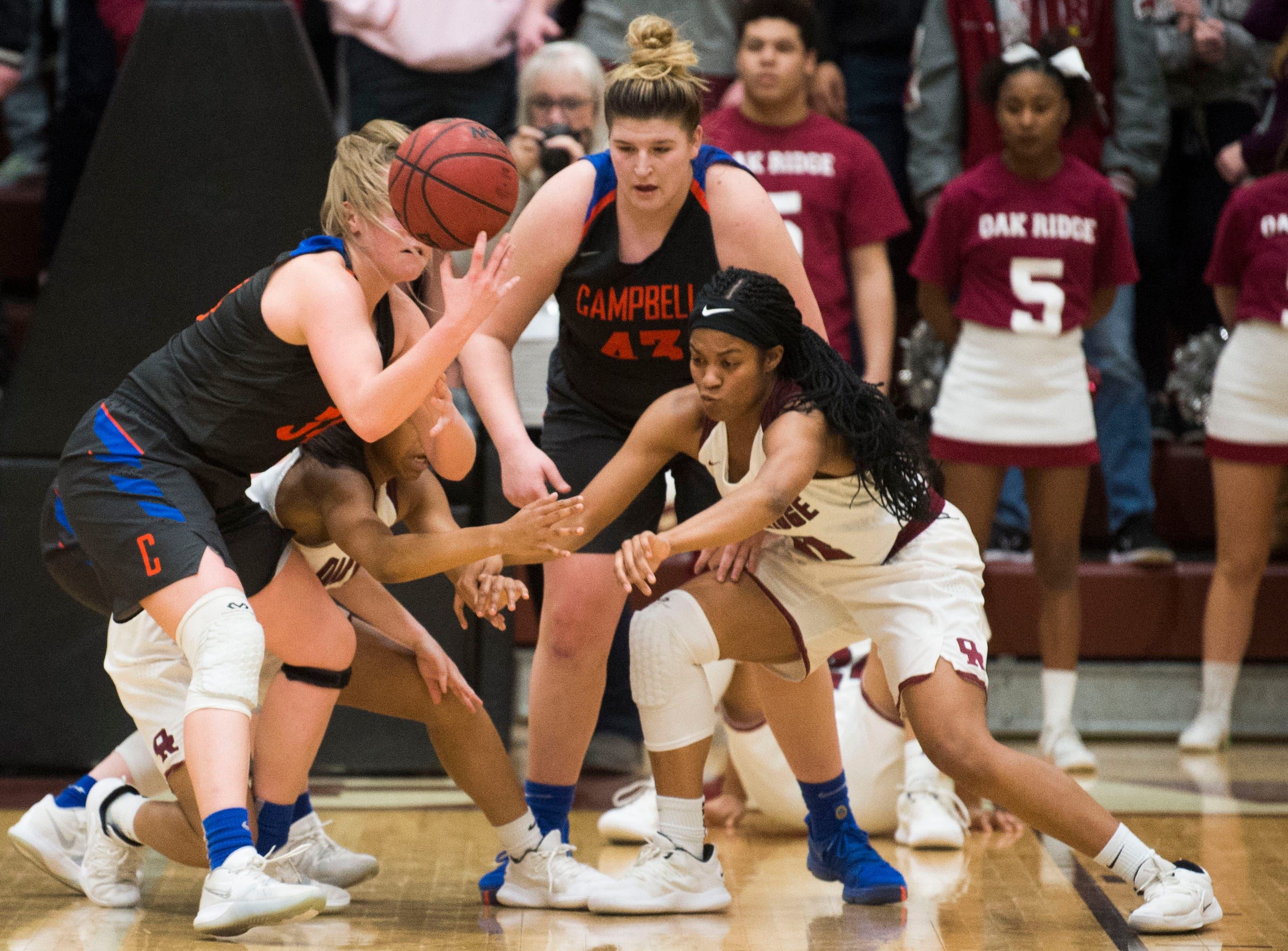 Players fight for possession of the ball during a high school basketball game between Oak Ridge and Campbell County at Oak Ridge Friday, Feb. 1, 2019.